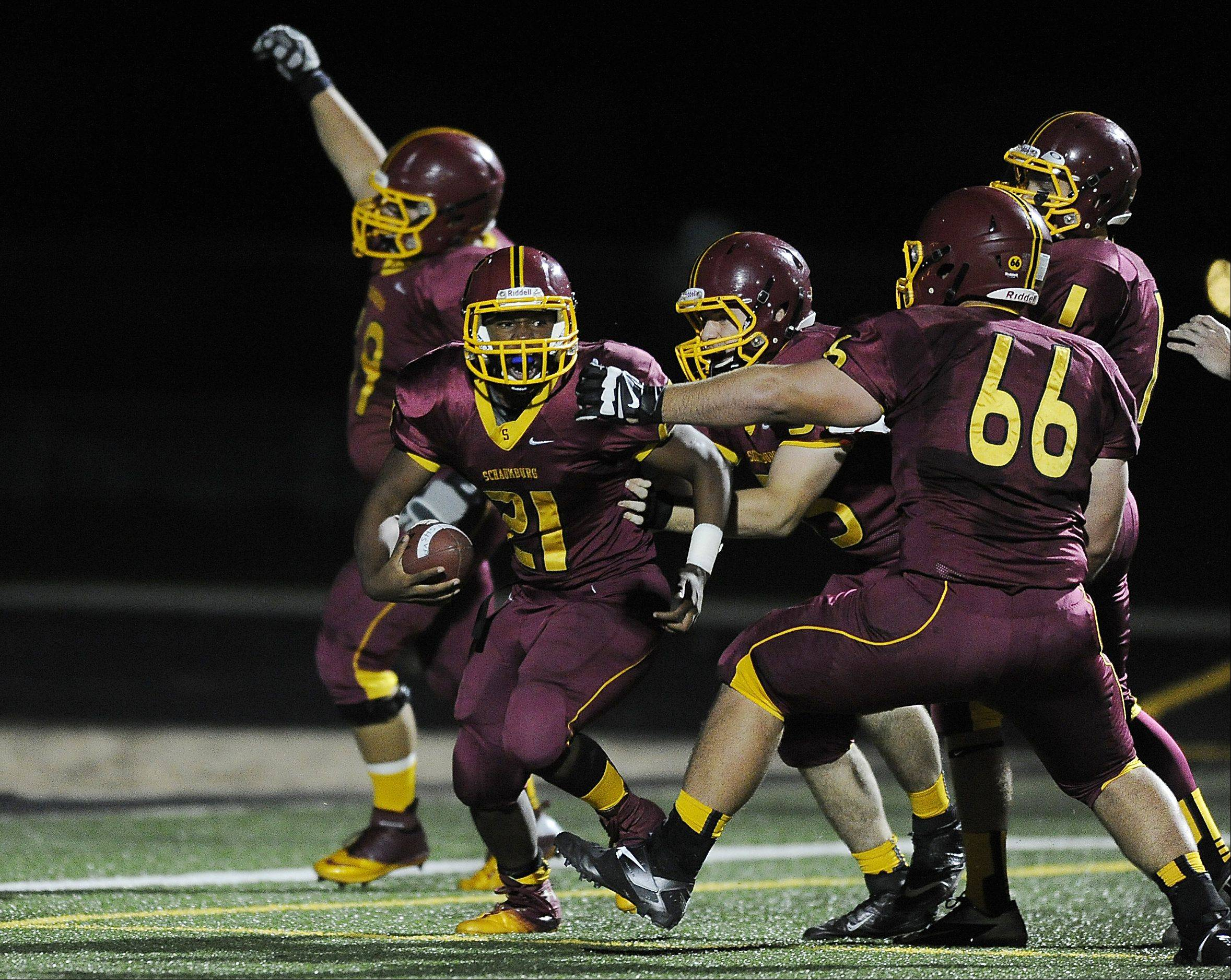 Schaumburg's Justice Macneal-Young celebrates a first-quarter touchdown.