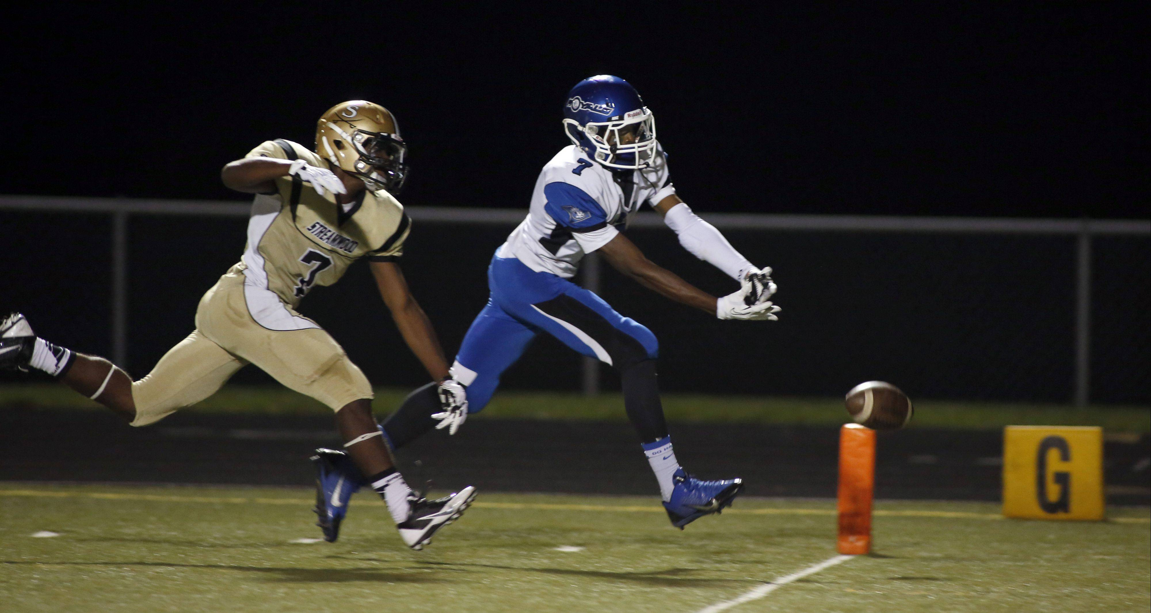 Streamwood's Cody Jayko, left, tries to defend a pass to Larkin's Dante Bonds on Friday.