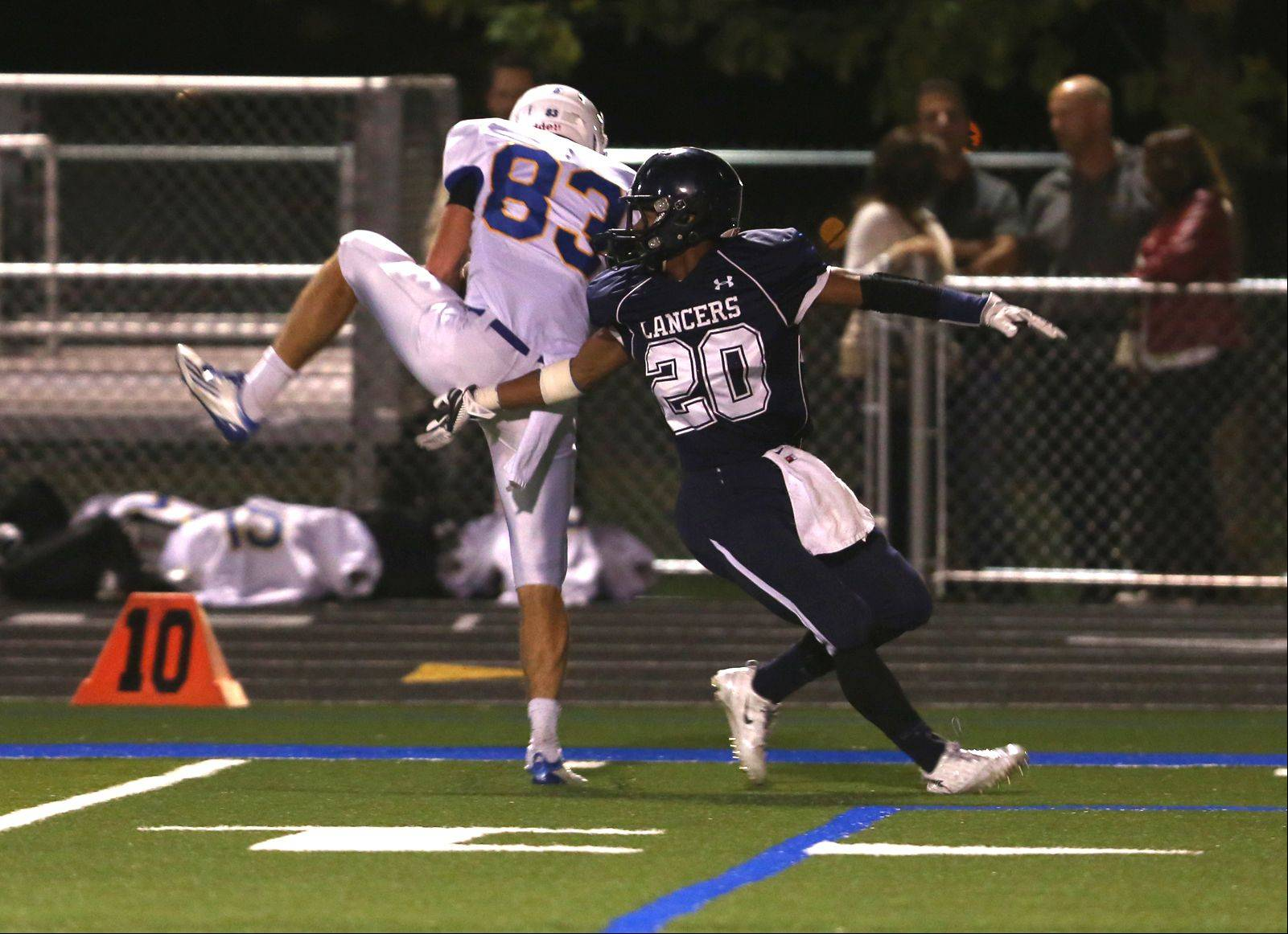 Wheaton North's Matt Biegalski, left, spins for a touchdown catch over Lake Park's Antonio Shenault, right.