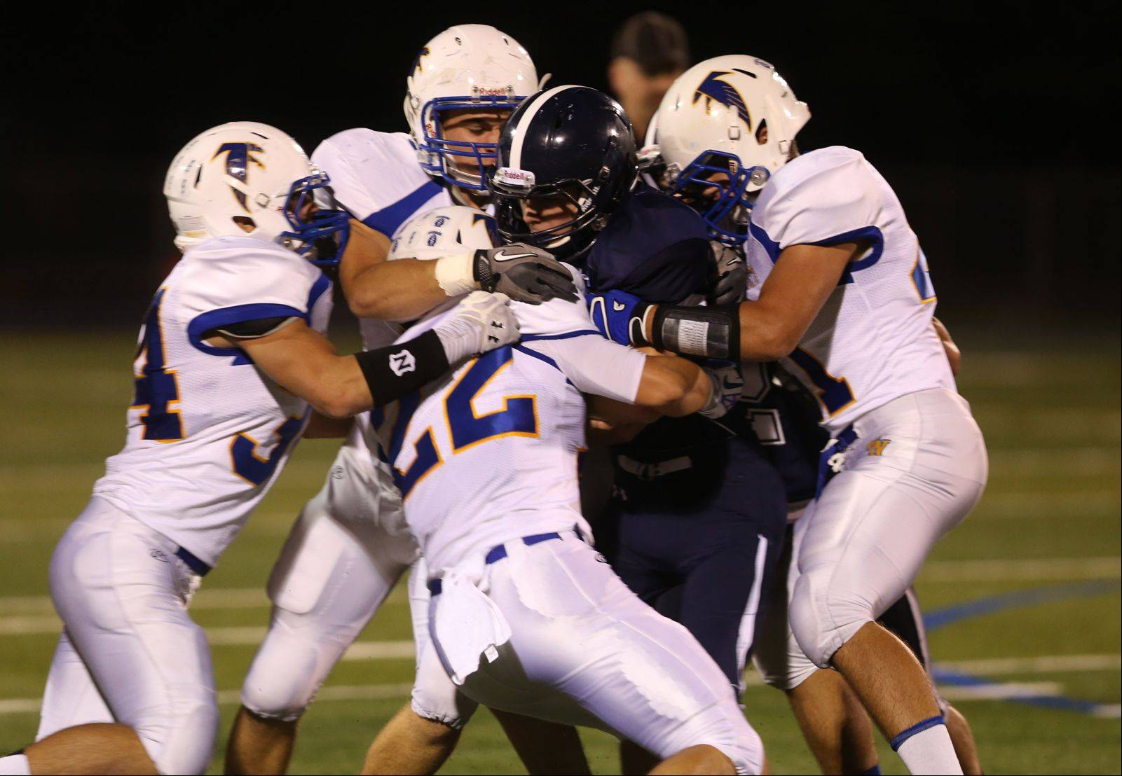 Lake Park quarterback Bobby Accetura gets sacked up by a host of Wheaton North defenders.
