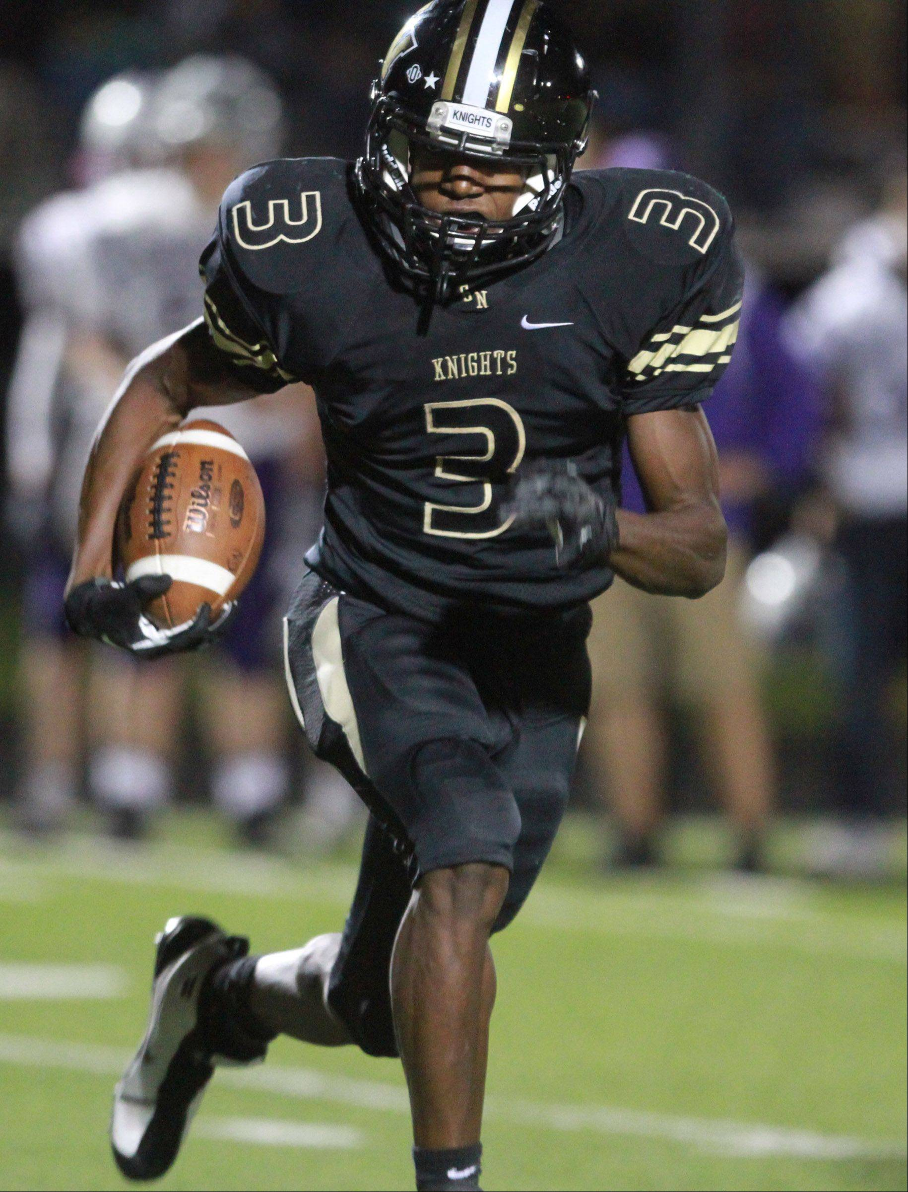 Grayslake North running back Titus Booker moves the ball.