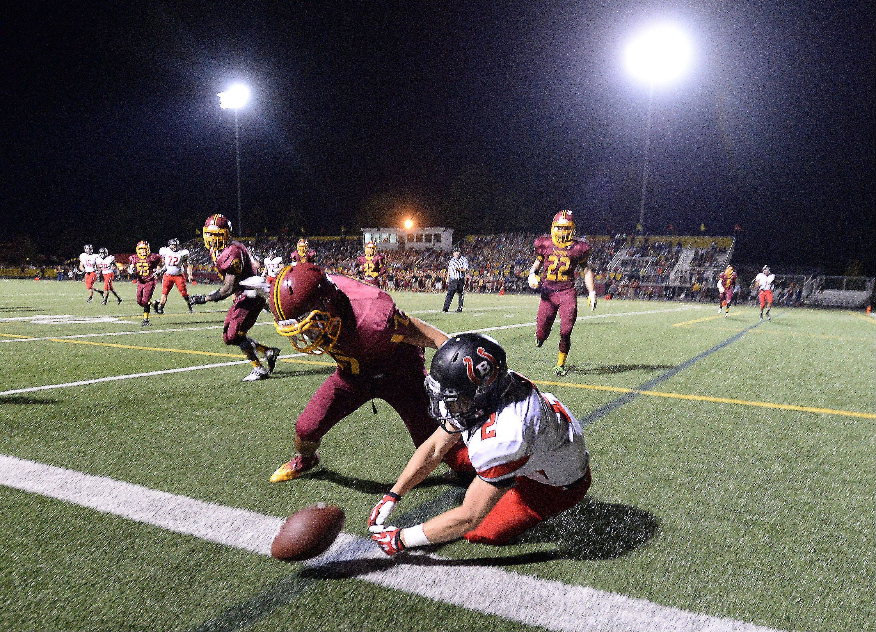Schaumburg's Chris Henson prevents Barrington's Matt Moran from picking up a first down near the goal line late in the second quarter at Schaumburg.