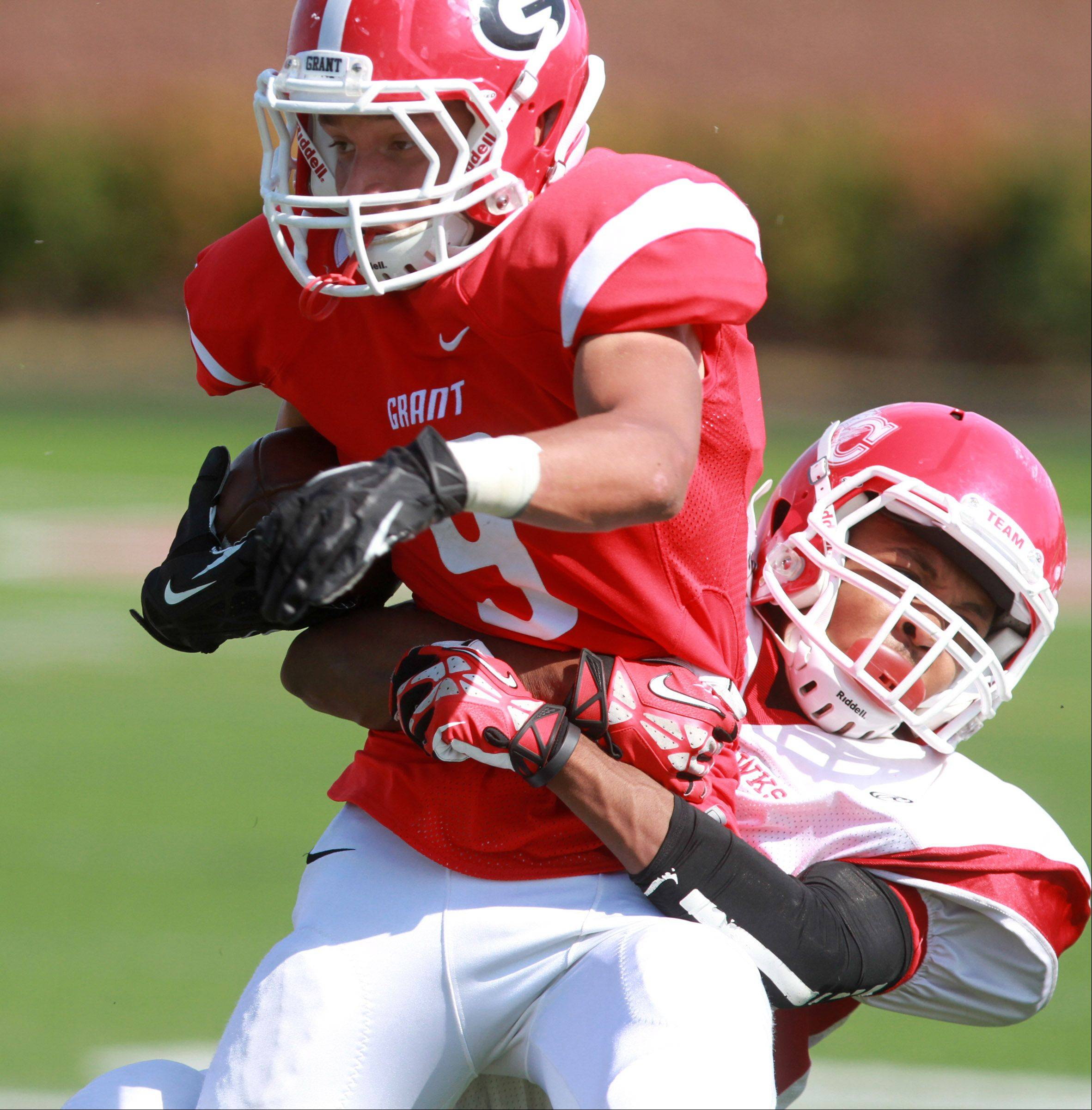 Grant running back Jeremy Bredwood is pulled down by a North Chicago defender at Grant on Saturday.