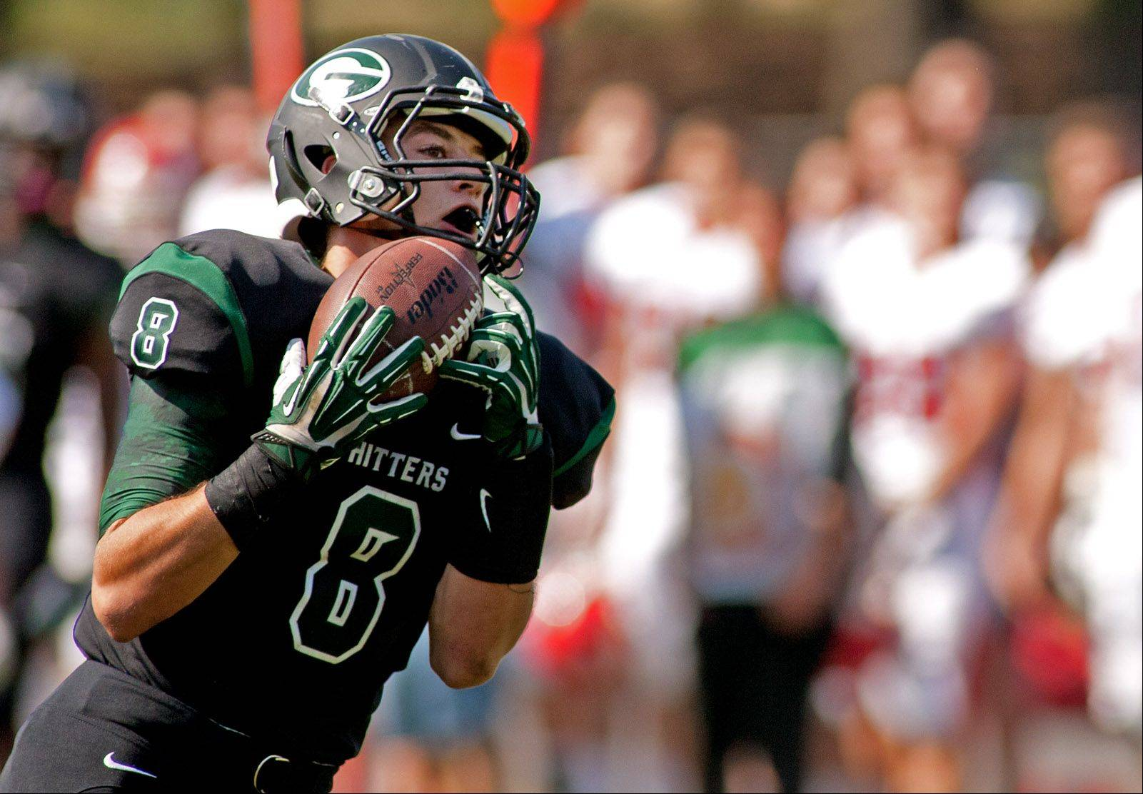 Glenbard West's Hayden Carlson catches a first half touchdown pass against Hinsdale Central.