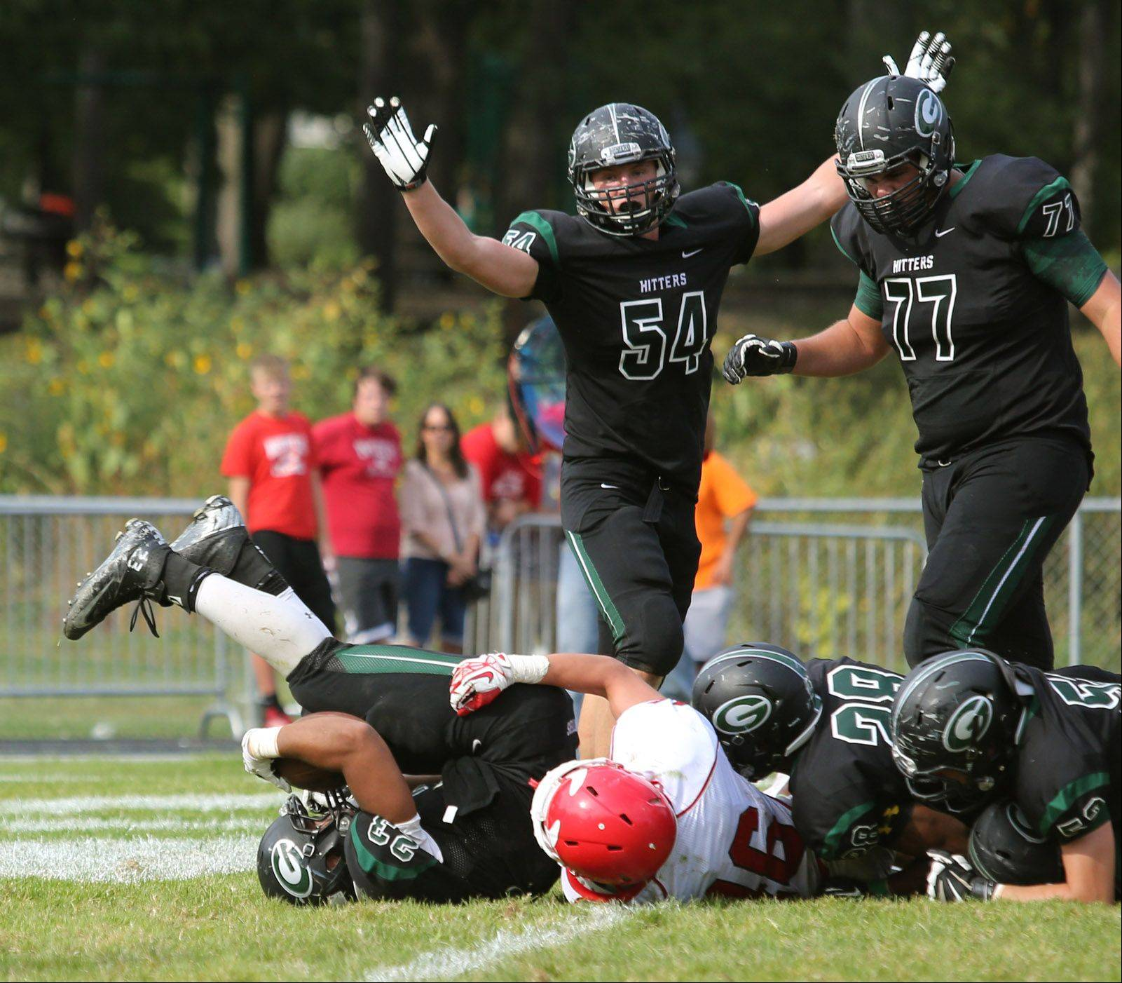 Glenbard West's Scott Andrews scores a second half touchdown against Hinsdale Central. Tedd Clauss, (54), and Eric Shute (77), join in the celebration.