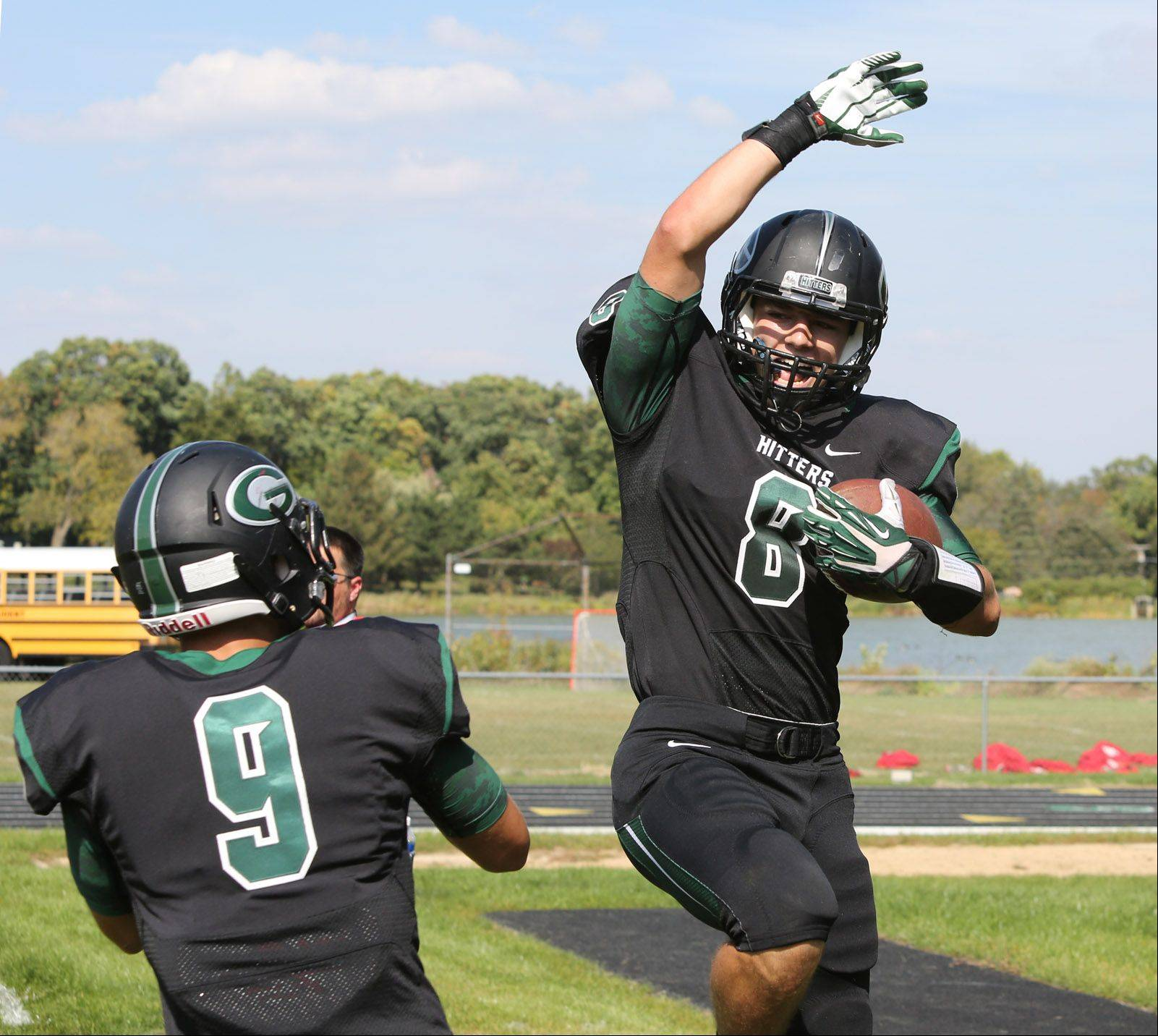 Glenbard West's Hayden Carlson, right, celebrates his first-half touchdown catch with teammate Connor Schrauth, left, against Hinsdale Central.