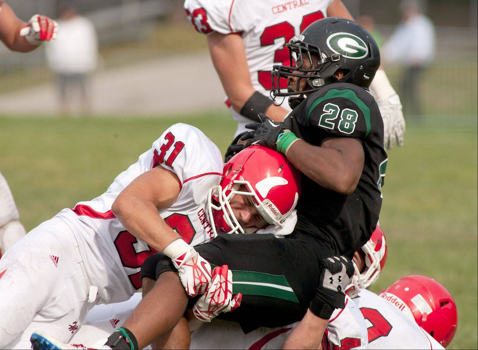 Glenbard West's Jermon Kindle Joyner is tackled by Hinsdale Central's Matt King.