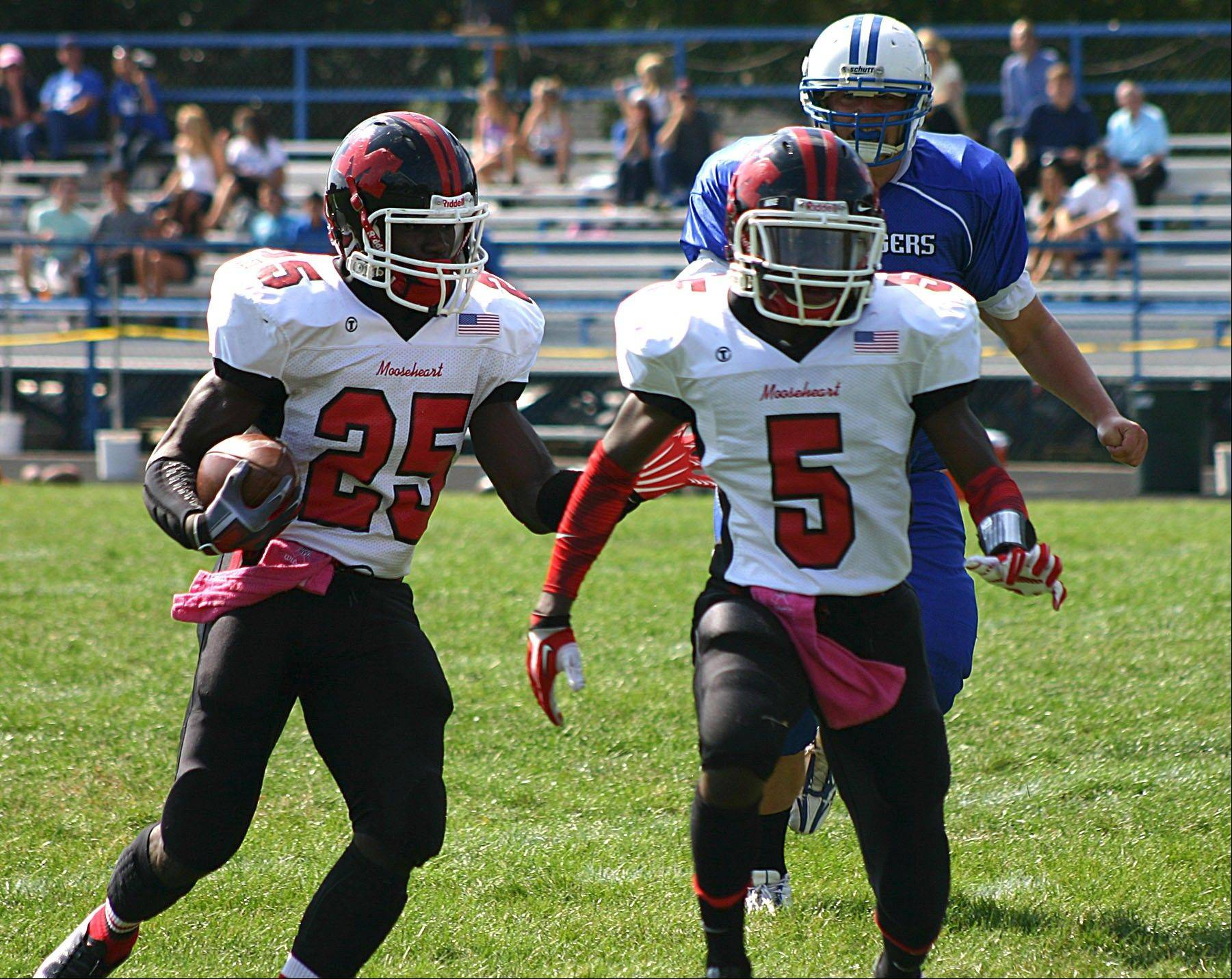Mooseheart's Joe Feemorlu (25) picks up yardage against Christian Liberty Academy on Saturday in Arlington Heights.