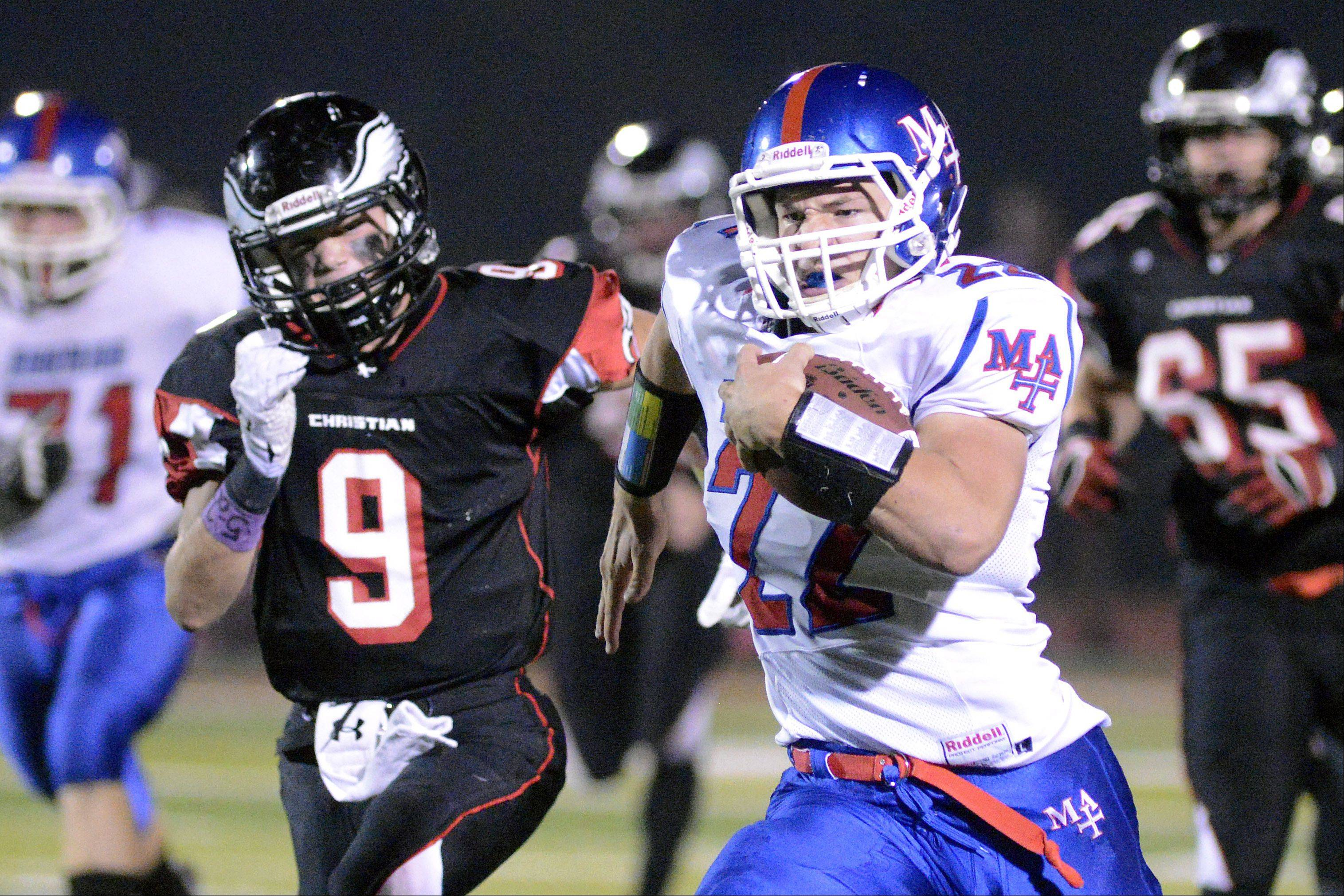 Marmion Academy's Jordan Glasgow sprints from Aurora Christian's defense on his way to scoring a touchdown in the first quarter on Friday, October 4.