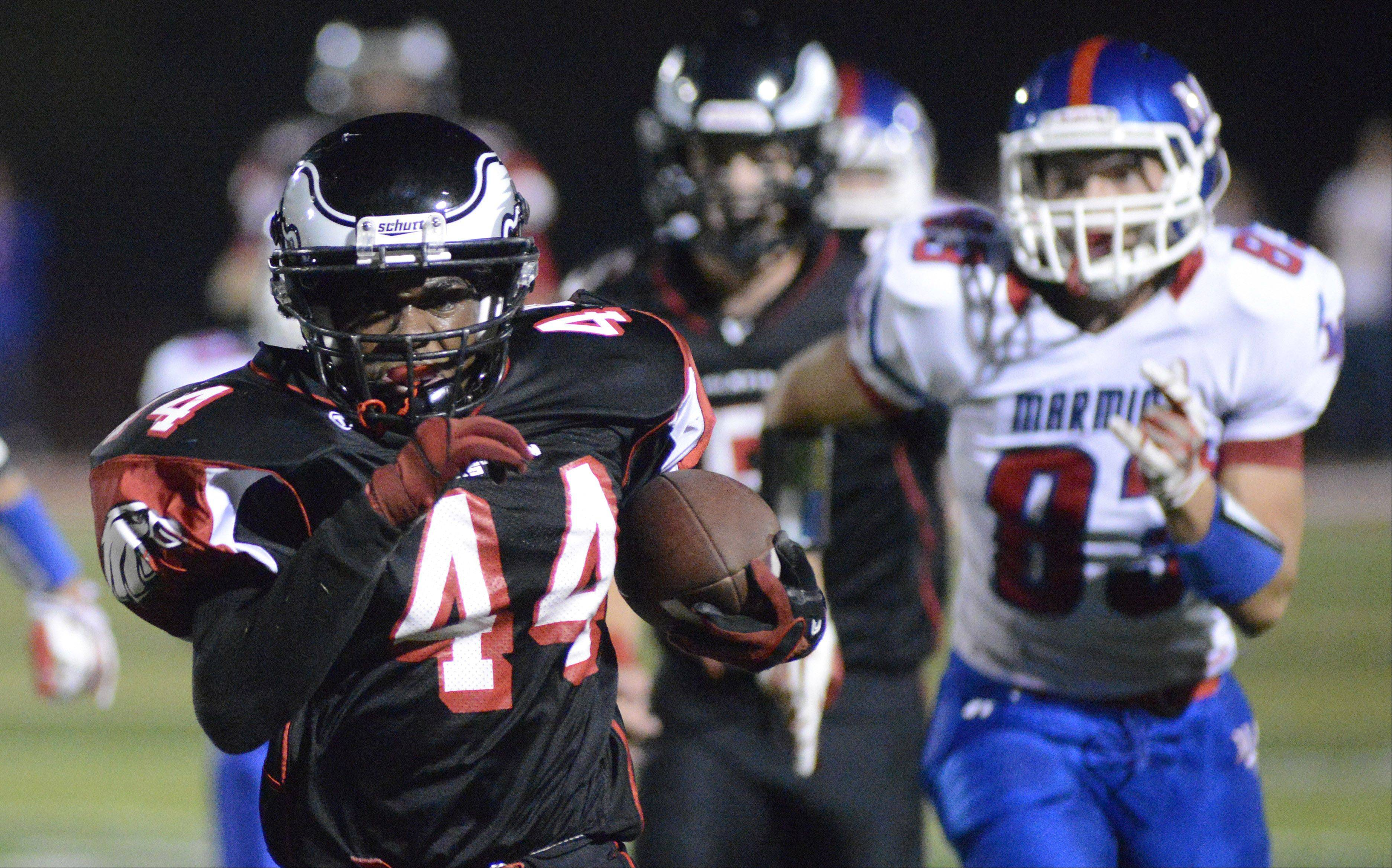 Aurora Christian's Legend Smith runs from Marmion Academy to the end zone in the second quarter on Friday, October 4.