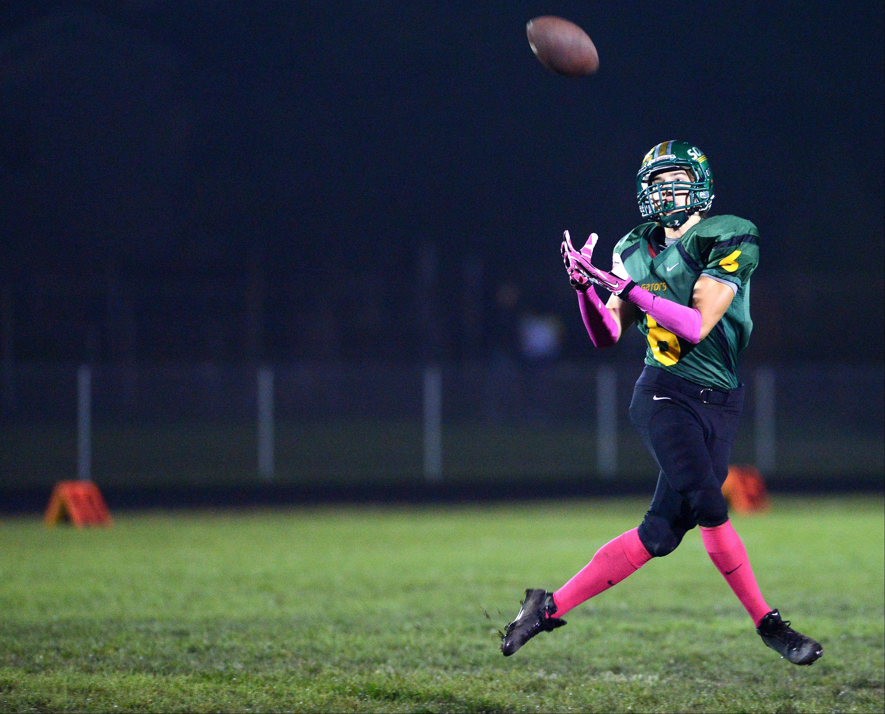Crystal Lake South's Phil Skrzypczak is wide open as he hauls in a pass on a halfback option.