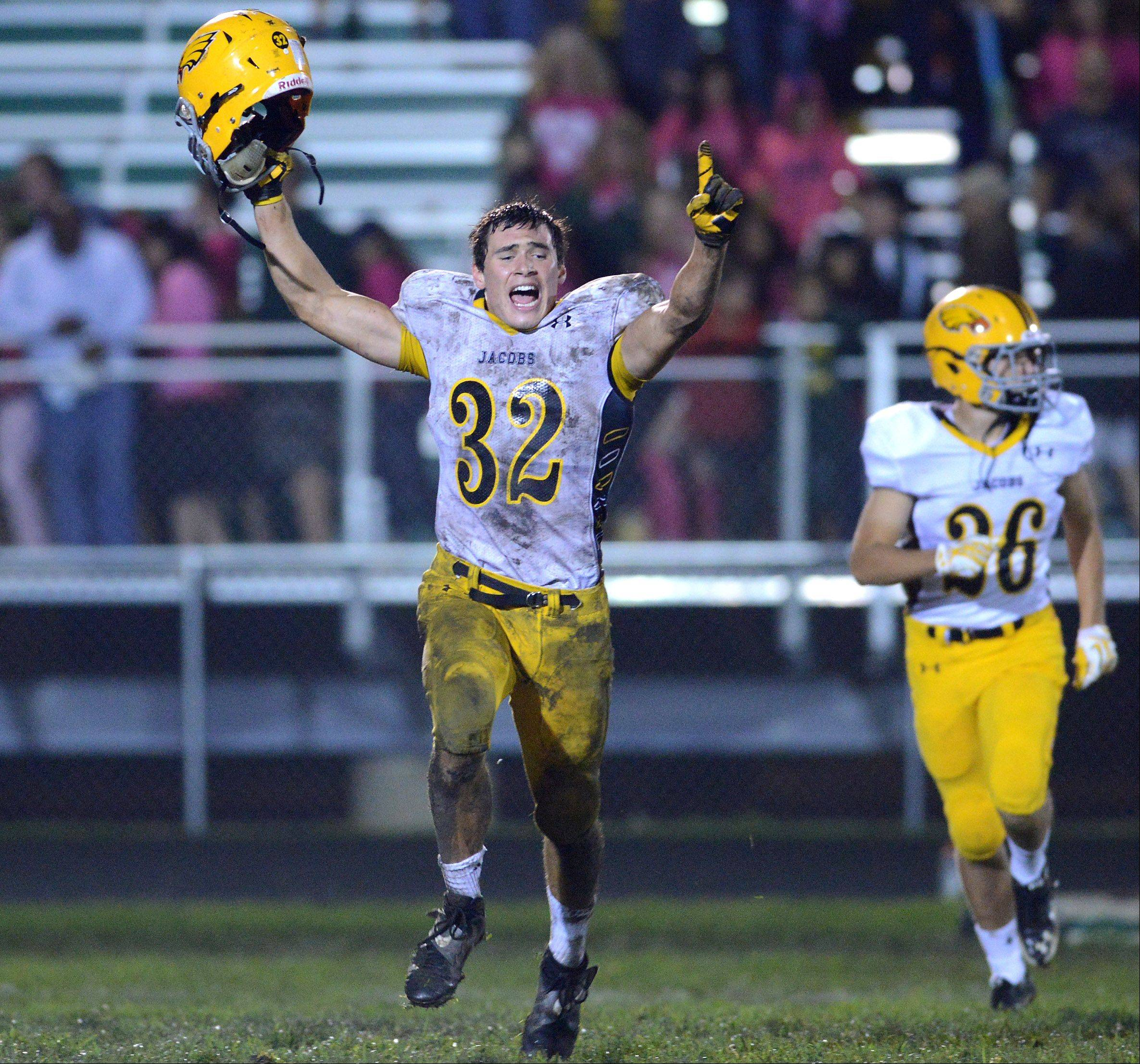 Jacobs' Matt Di Fecchio and his teammates run off the field following their last-second win over Crystal Lake South .