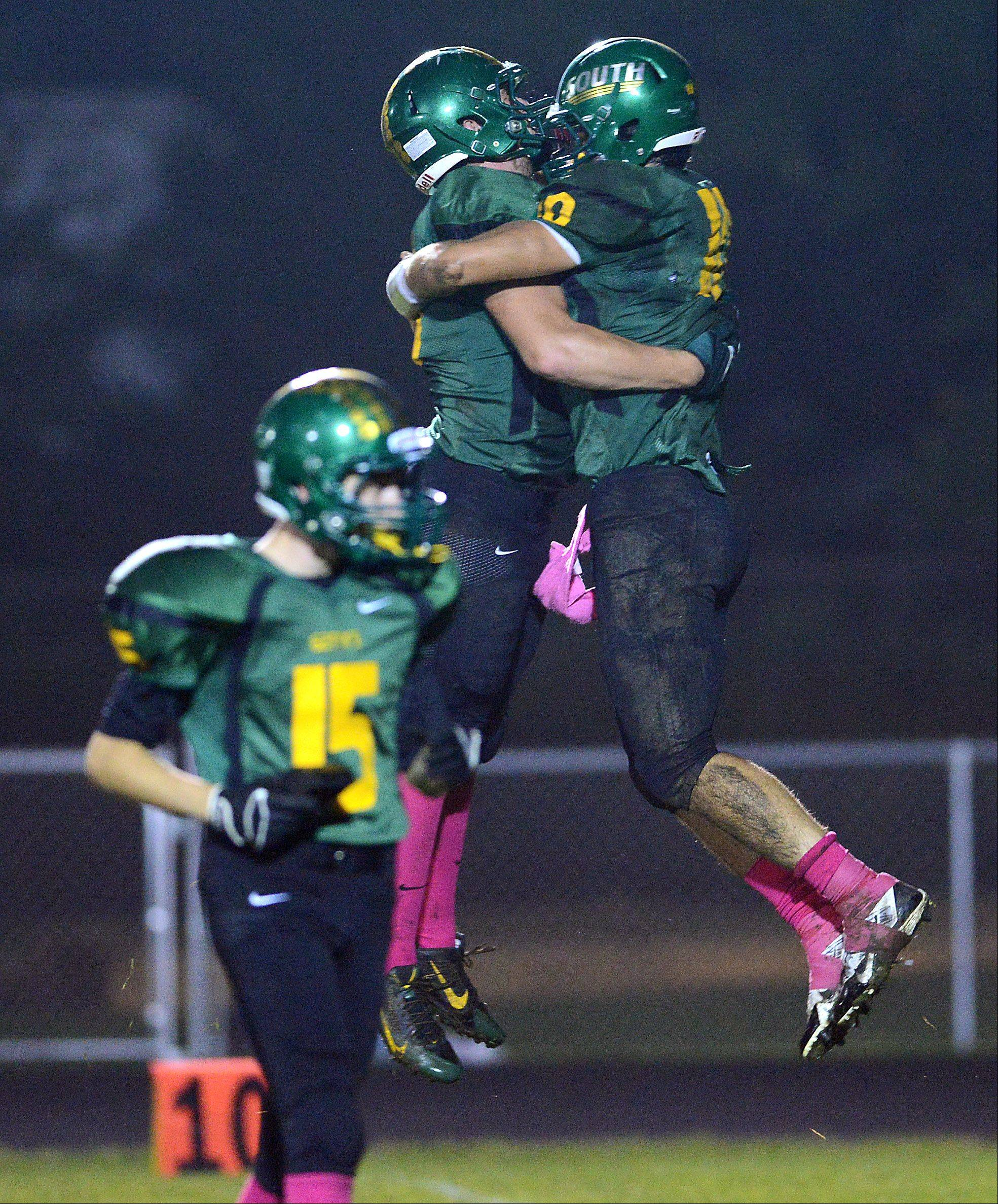 Crystal Lake South's Pat Walsh, left and Austin Rogers celebrate a touchdown.