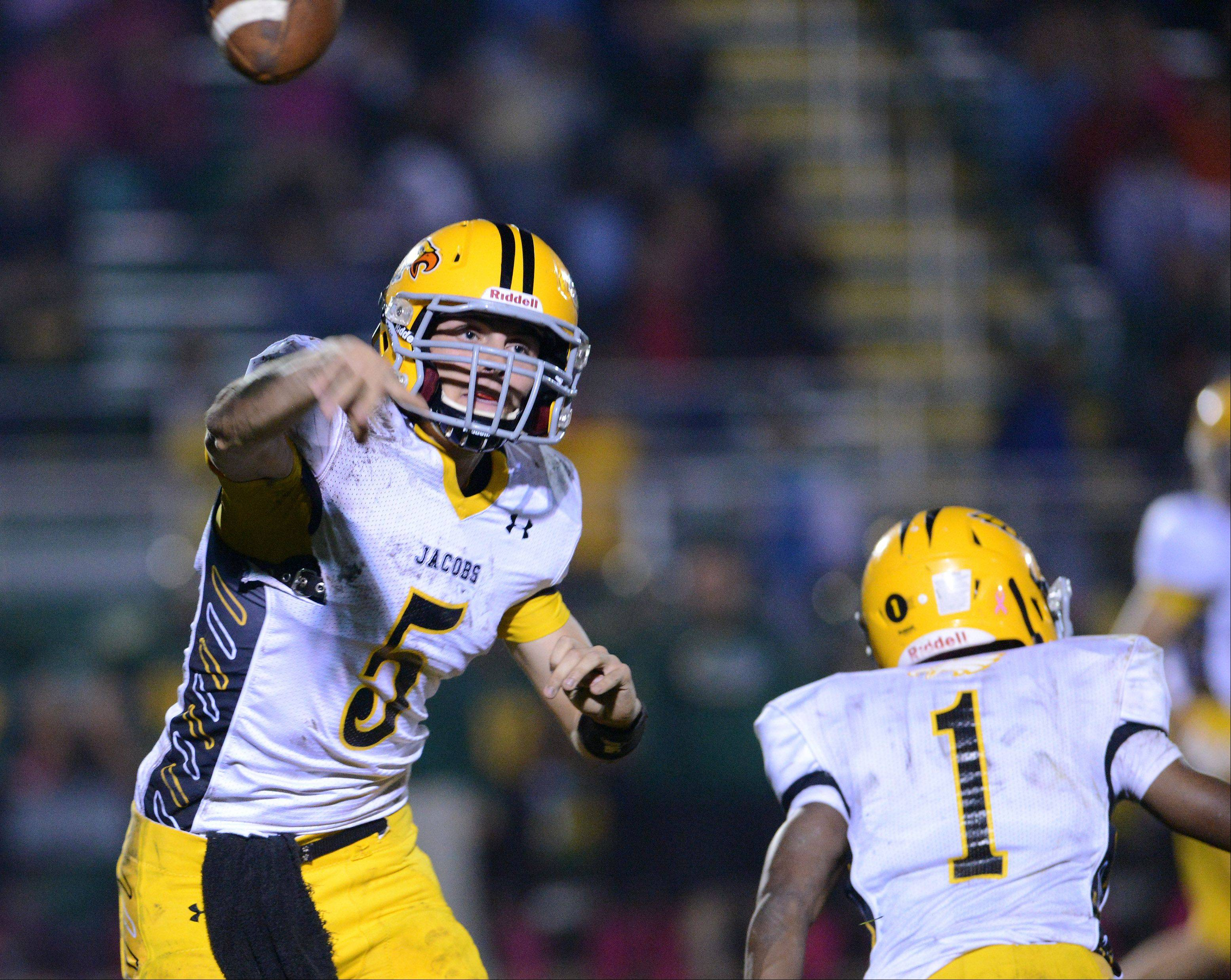 Quarterback Bret Mooney of Jacobs throws a pass .