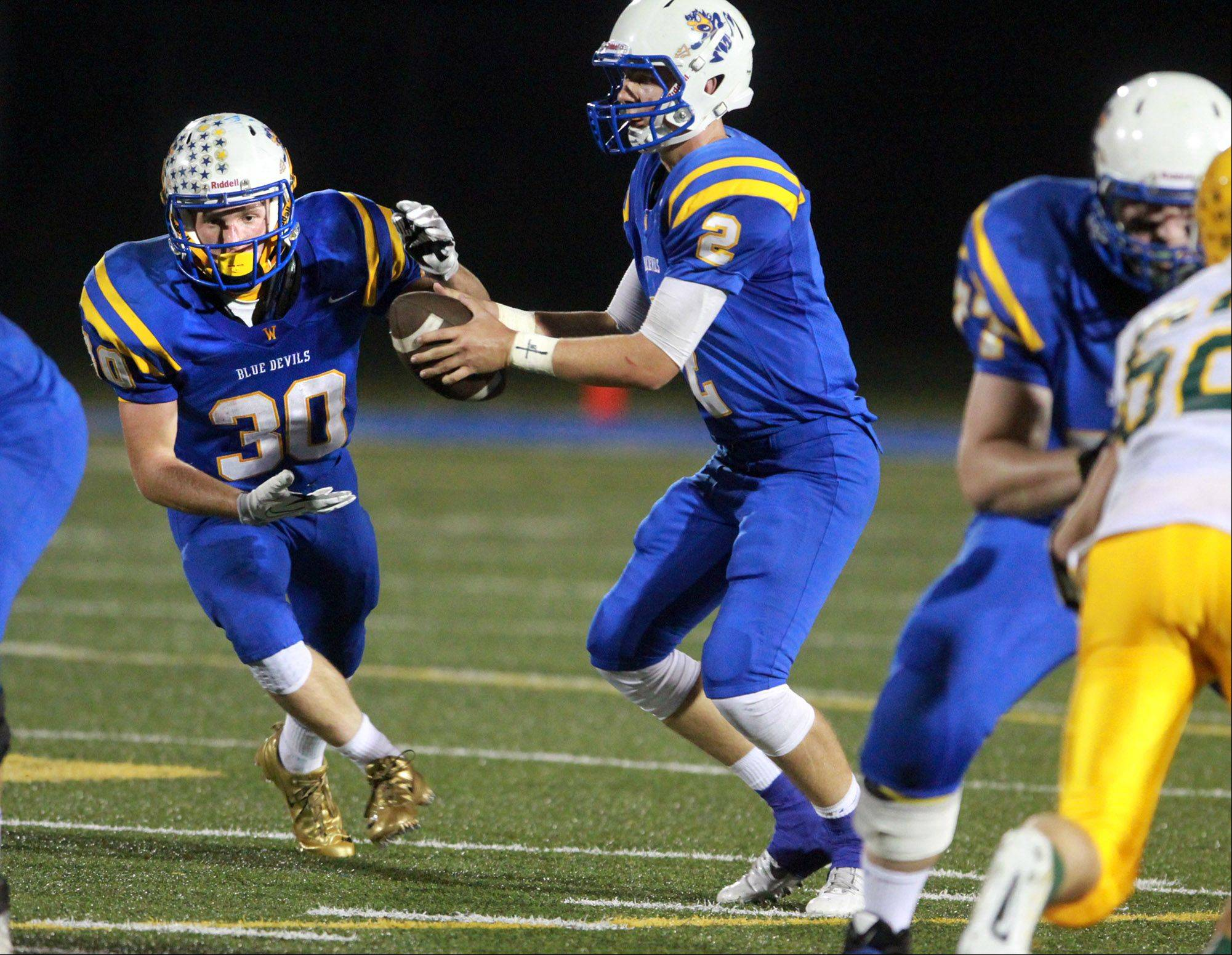 Warren quarterback Andrew Nickell hands off to running back Maxwell Sorby against Stevenson.