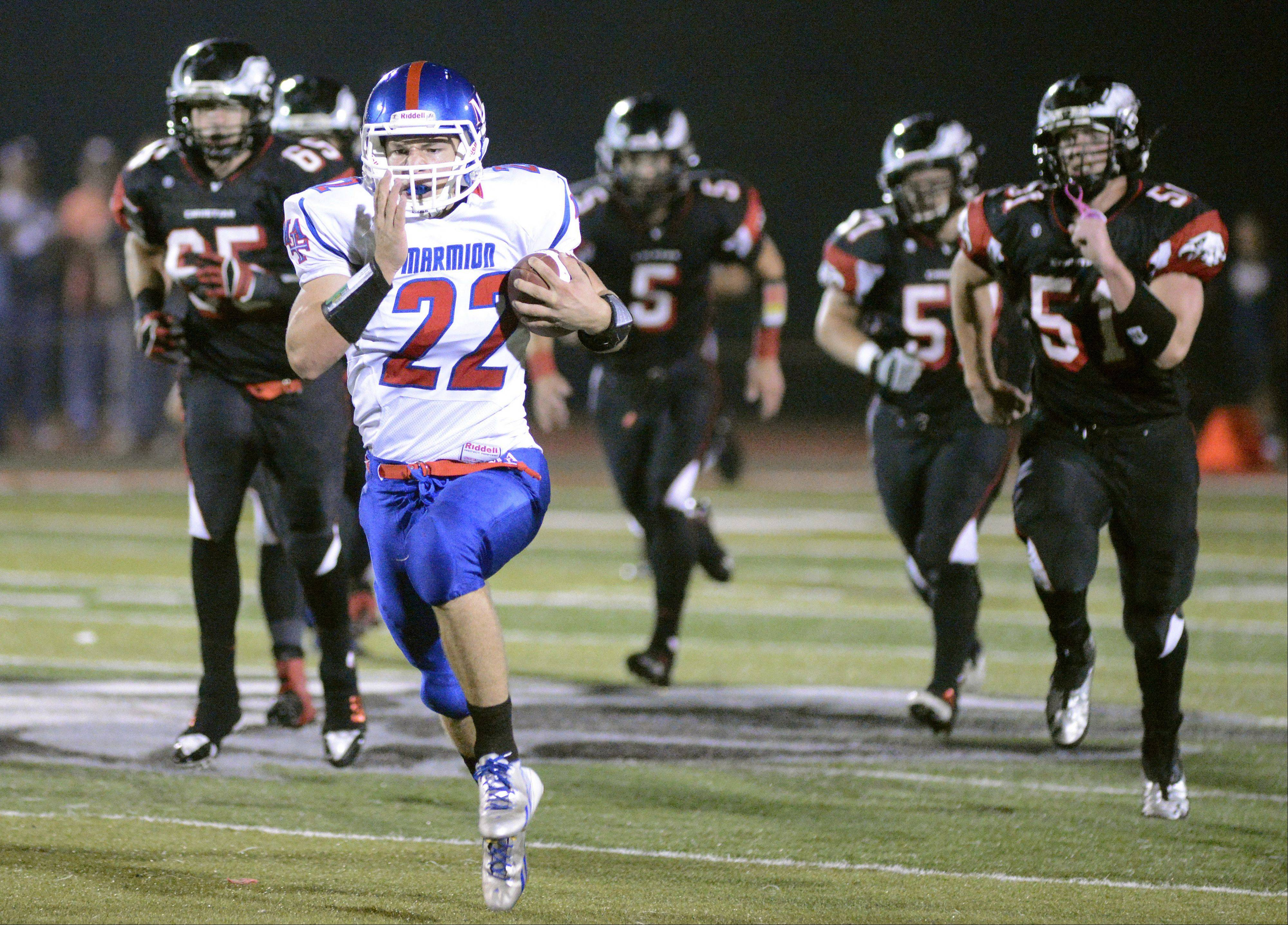 Marmion Academy's Jordan Glasgow sprints from Aurora Christian's defense on his way to scoring a touchdown in the first quarter.