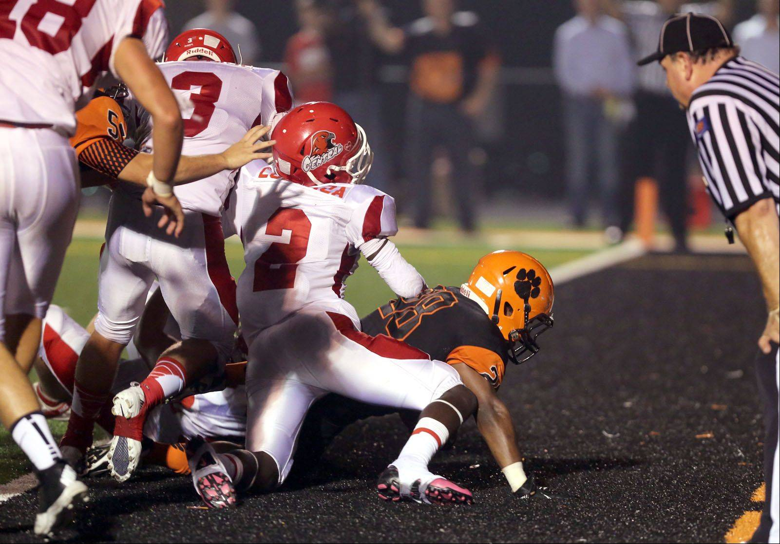 Wheaton Warrenville South's Isaiah Campos scores a first-half touchdown against Naperville Central.