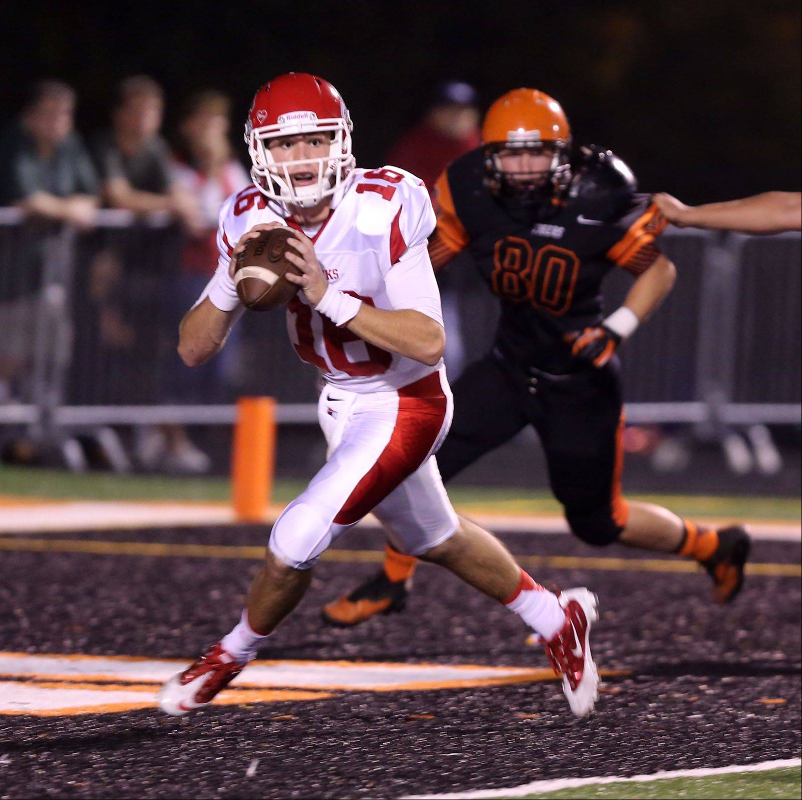 Naperville Central quarterback Jake Kolbe rolls out of the endzone against Wheaton Warrenville South.