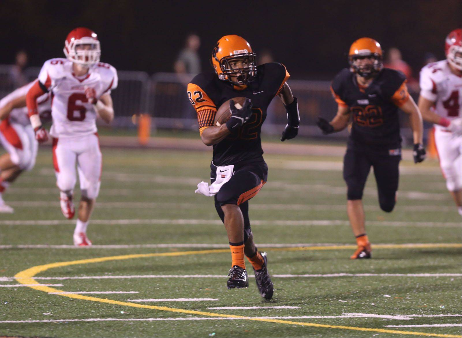 Wheaton Warrenville South's Keishawn Watson returns a punt against Naperville Central.