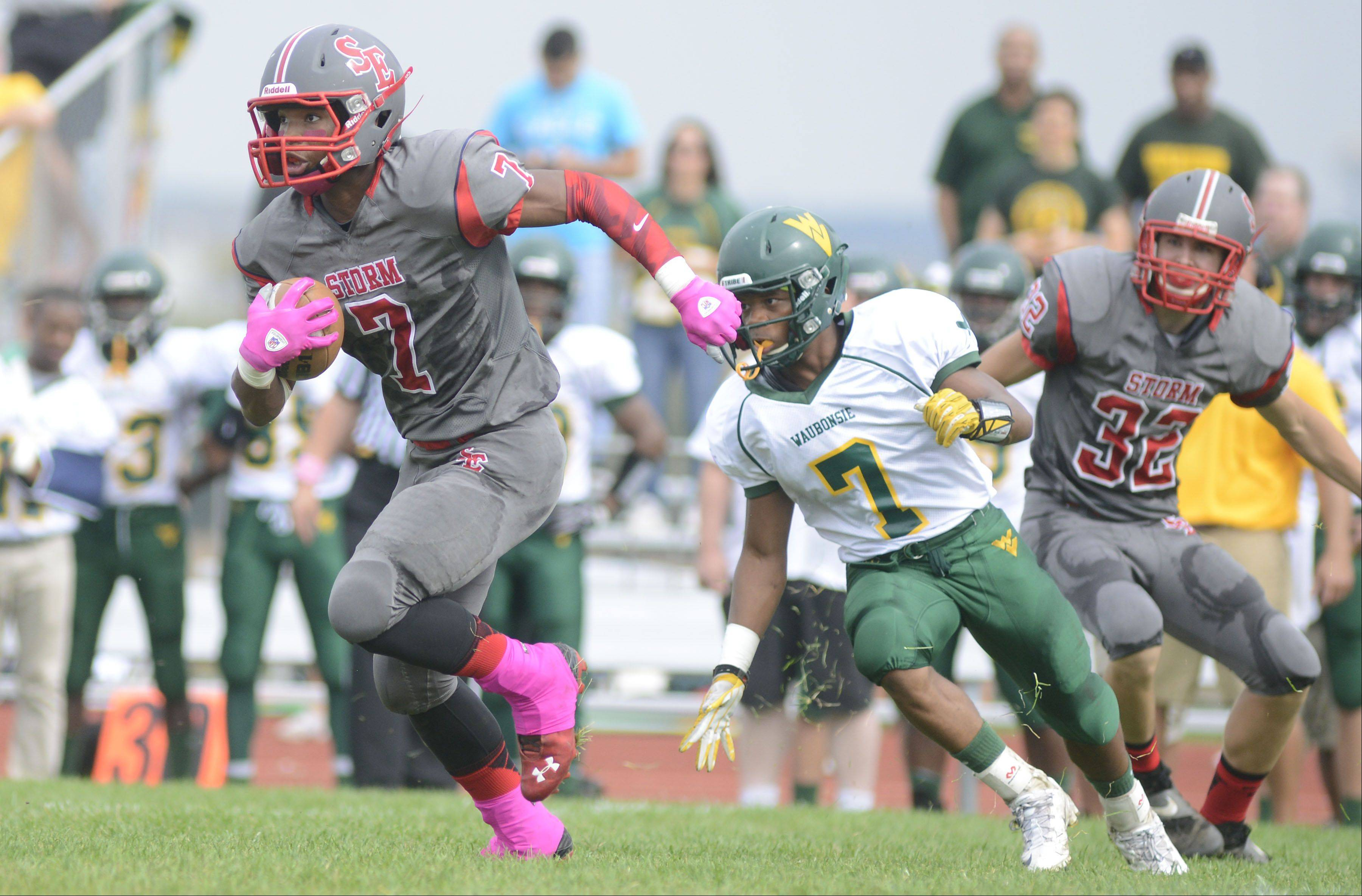 South Elgin's Willy King zips past Waubonsie Valley's Tony Durns Saturday.