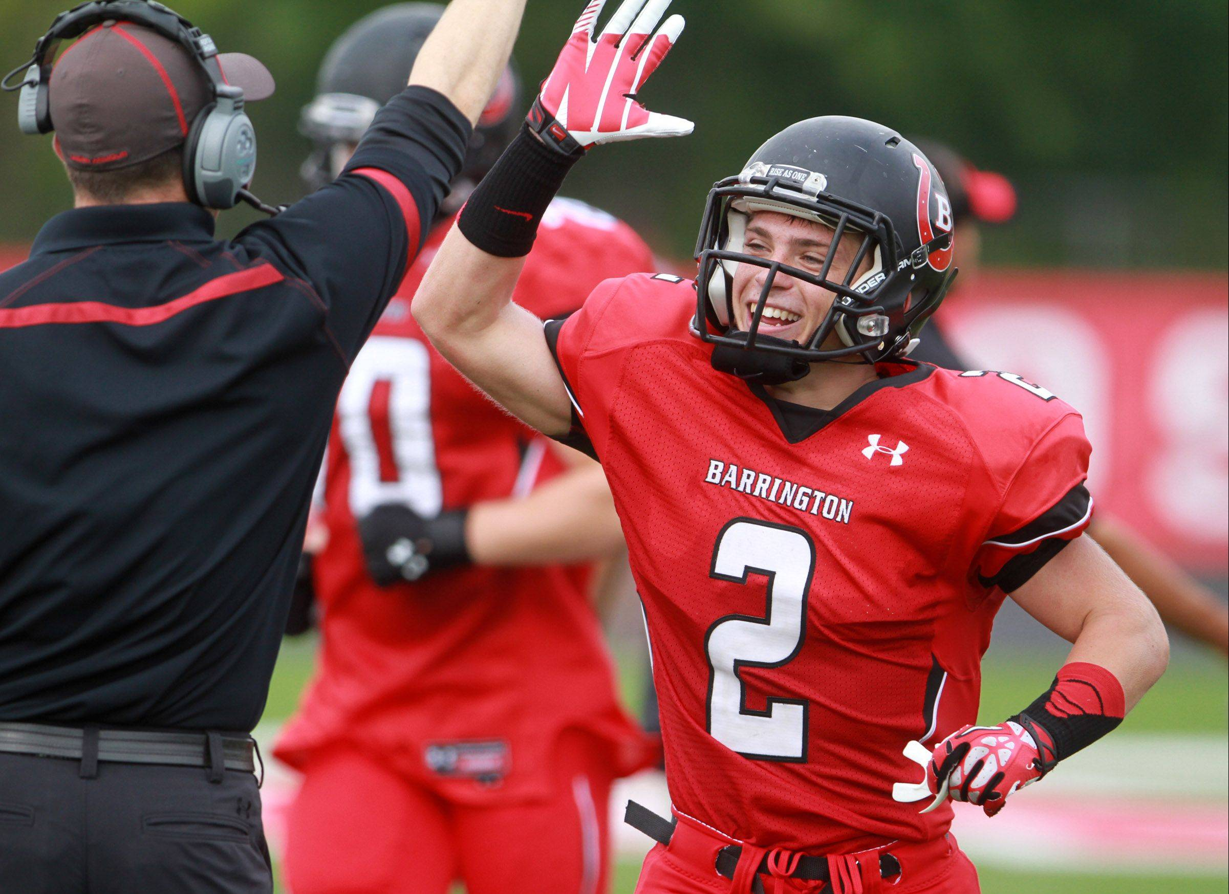 Barrington receiver Matt Moran celebrates a touchdown as he returns to the sideline against Fremd at Barrington on Saturday.