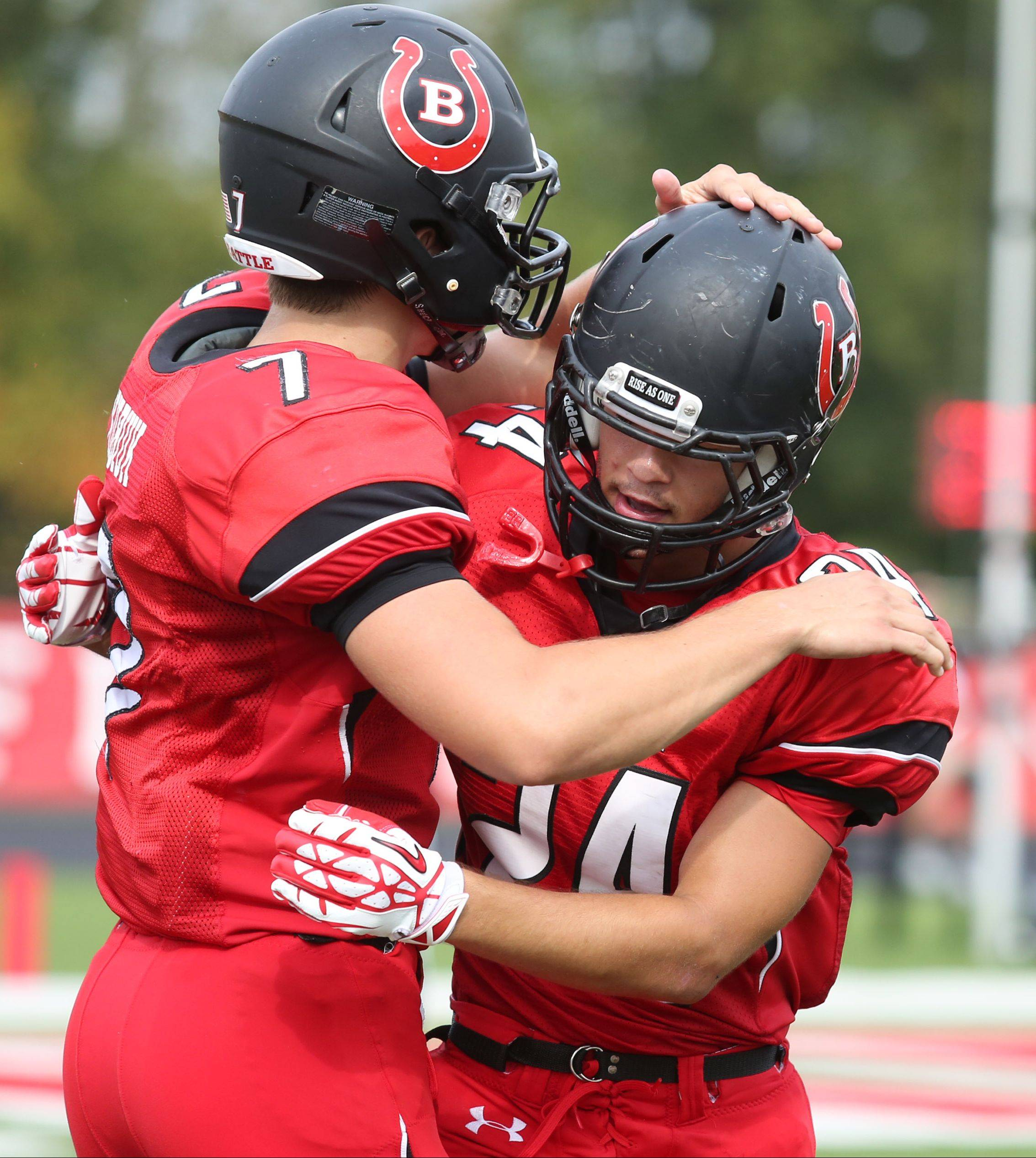 Barrington Dylan Bingham, right, gets a hand from quarterback Dan Kubiuk after Bingham ran for a touchdown against Fremd.