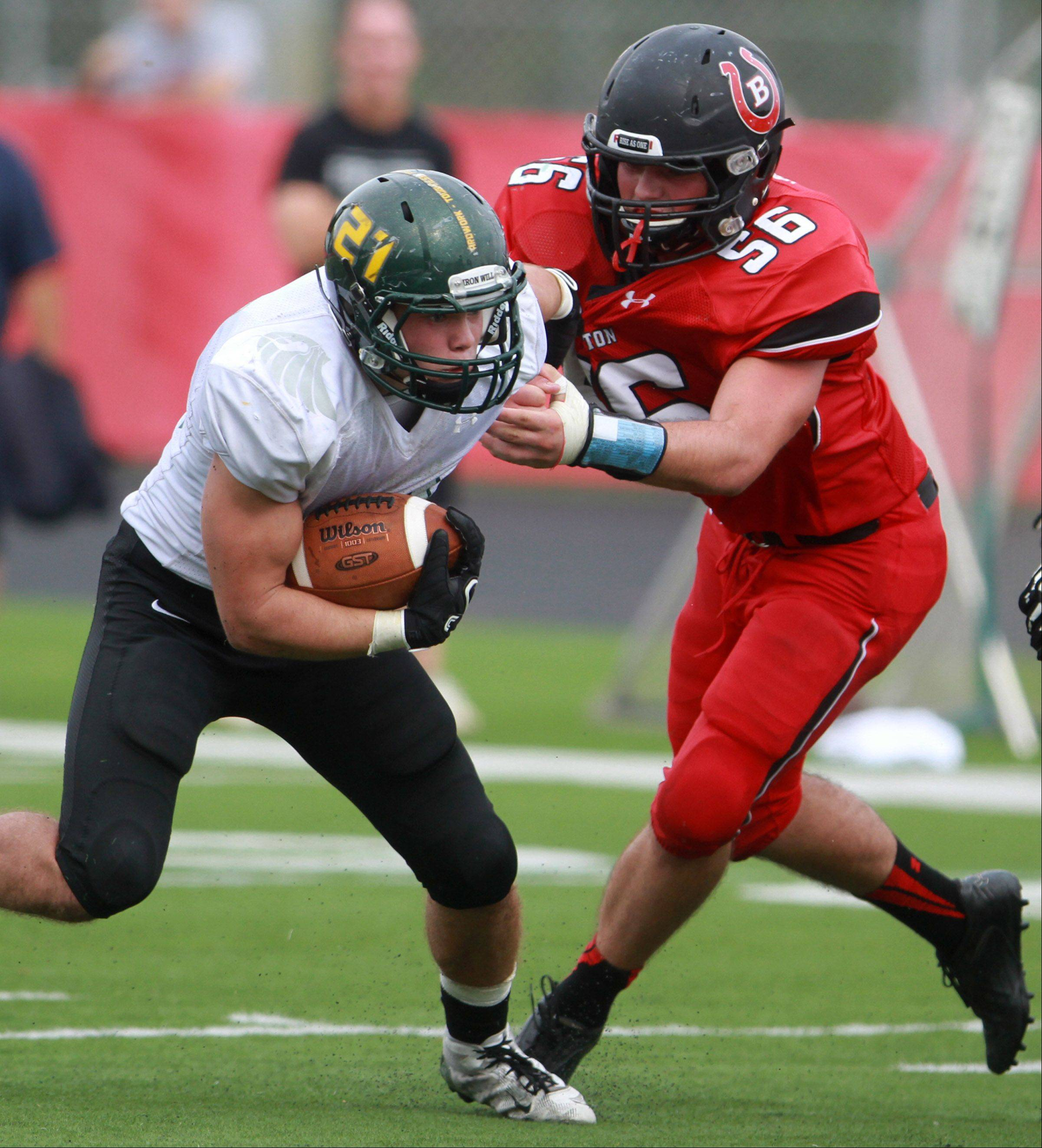 Barrington defender Ryan Blair pulls down Fremd running-back Jeff McGlade at Barrington on Saturday.