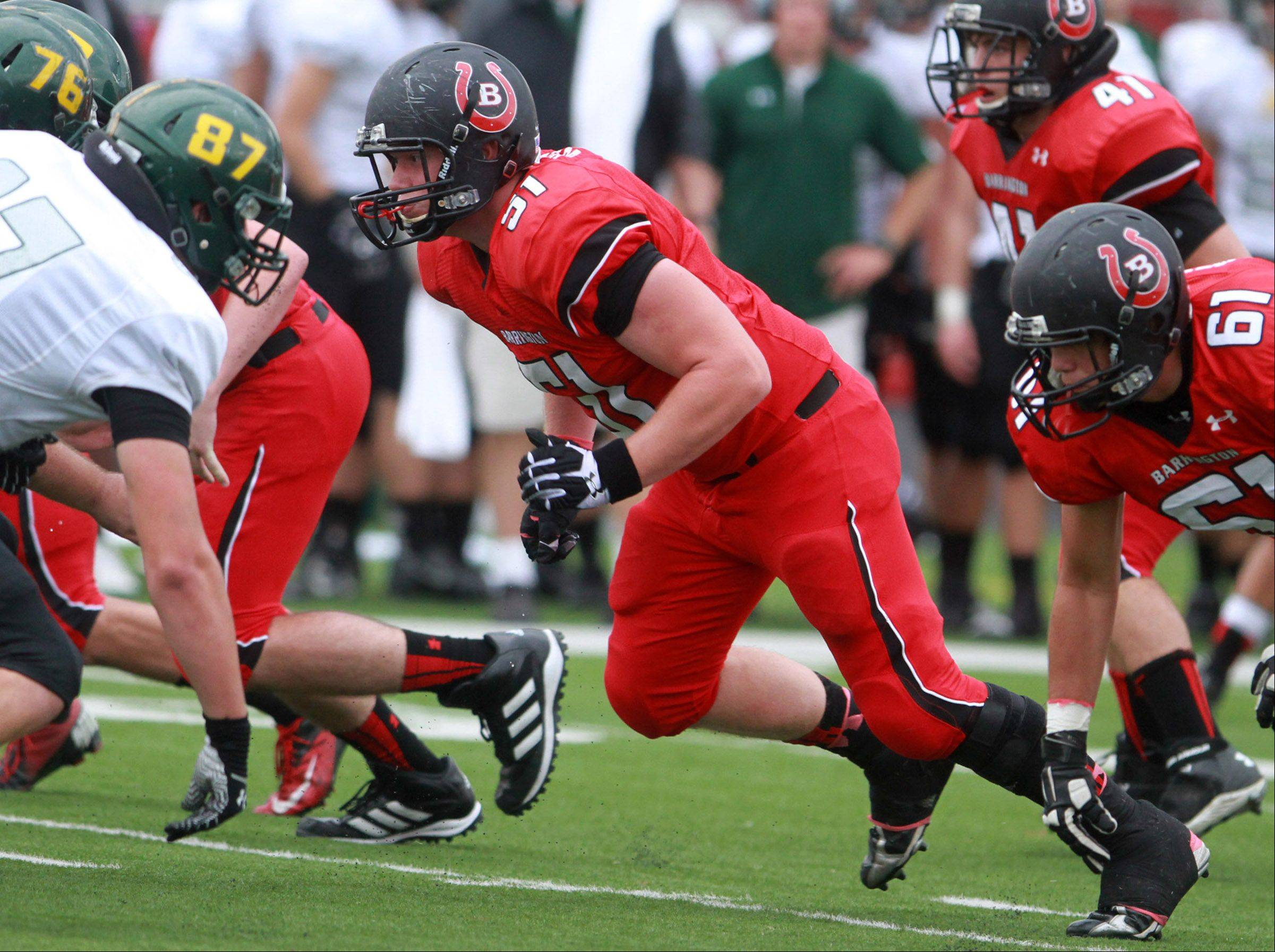 Barrington Jacob Bulandr looks for the run in front of Fremd offensive linemen at Barrington on Saturday,October 5.
