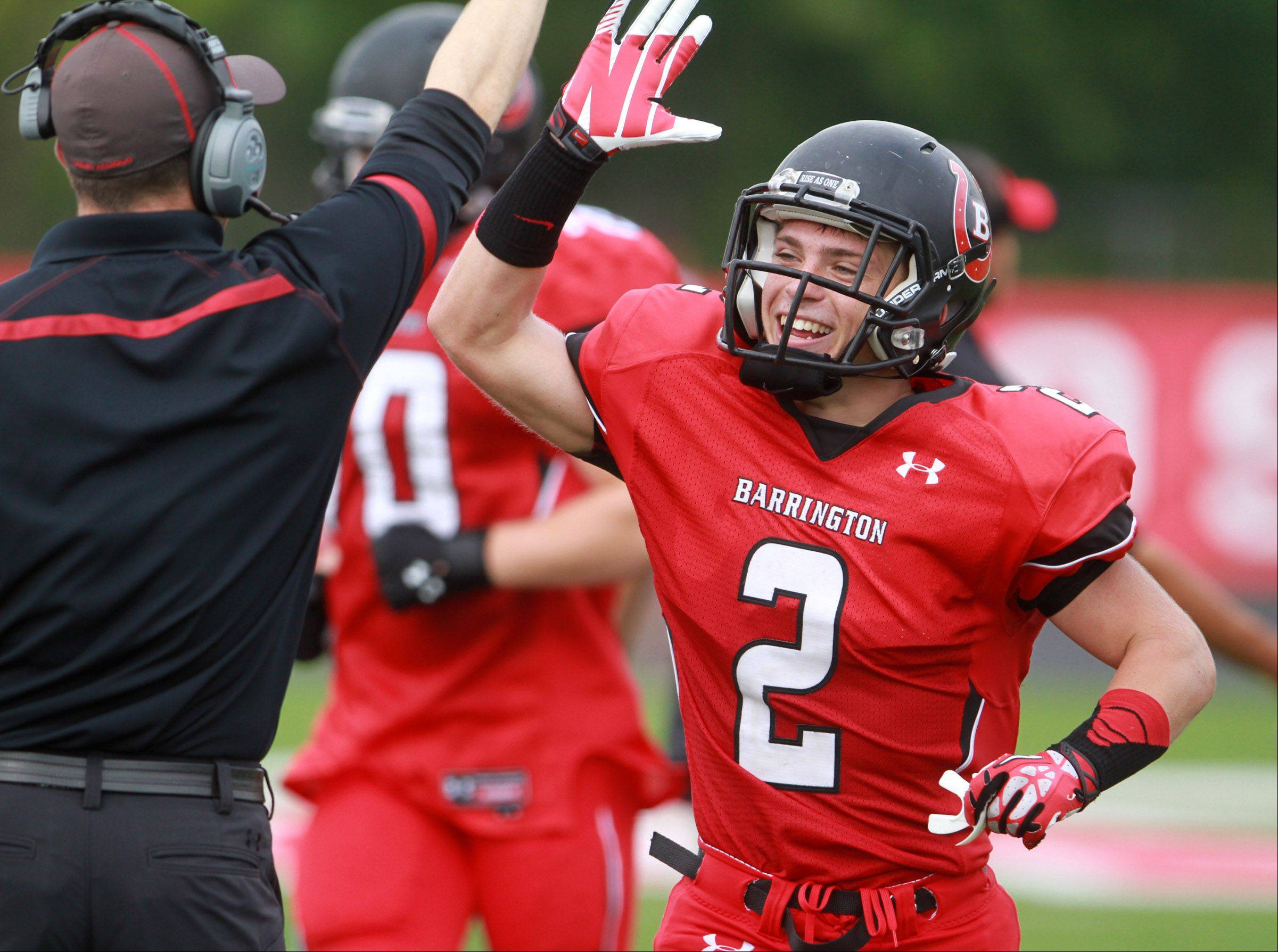 Barrington wide-receiver Matt Moran celebrates a touchdown as he returns to the sideline against Fremd at Barrington on Saturday,October 5.