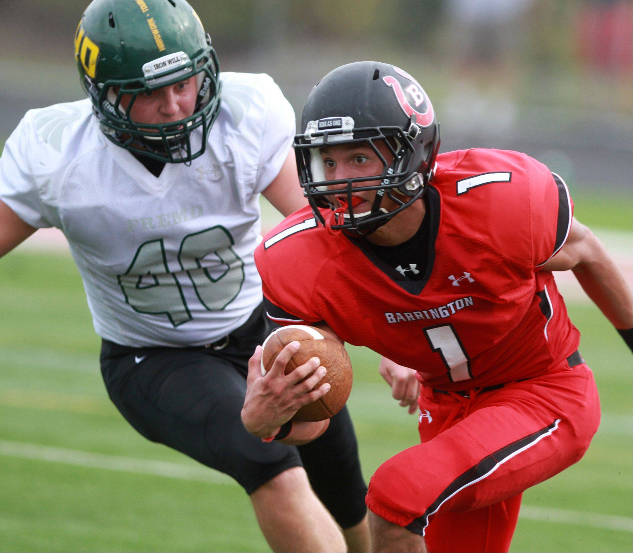 Barrington's Scotty Miller escapes Fremd defender Ryan Tarallo at Barrington on Saturday,October 5.