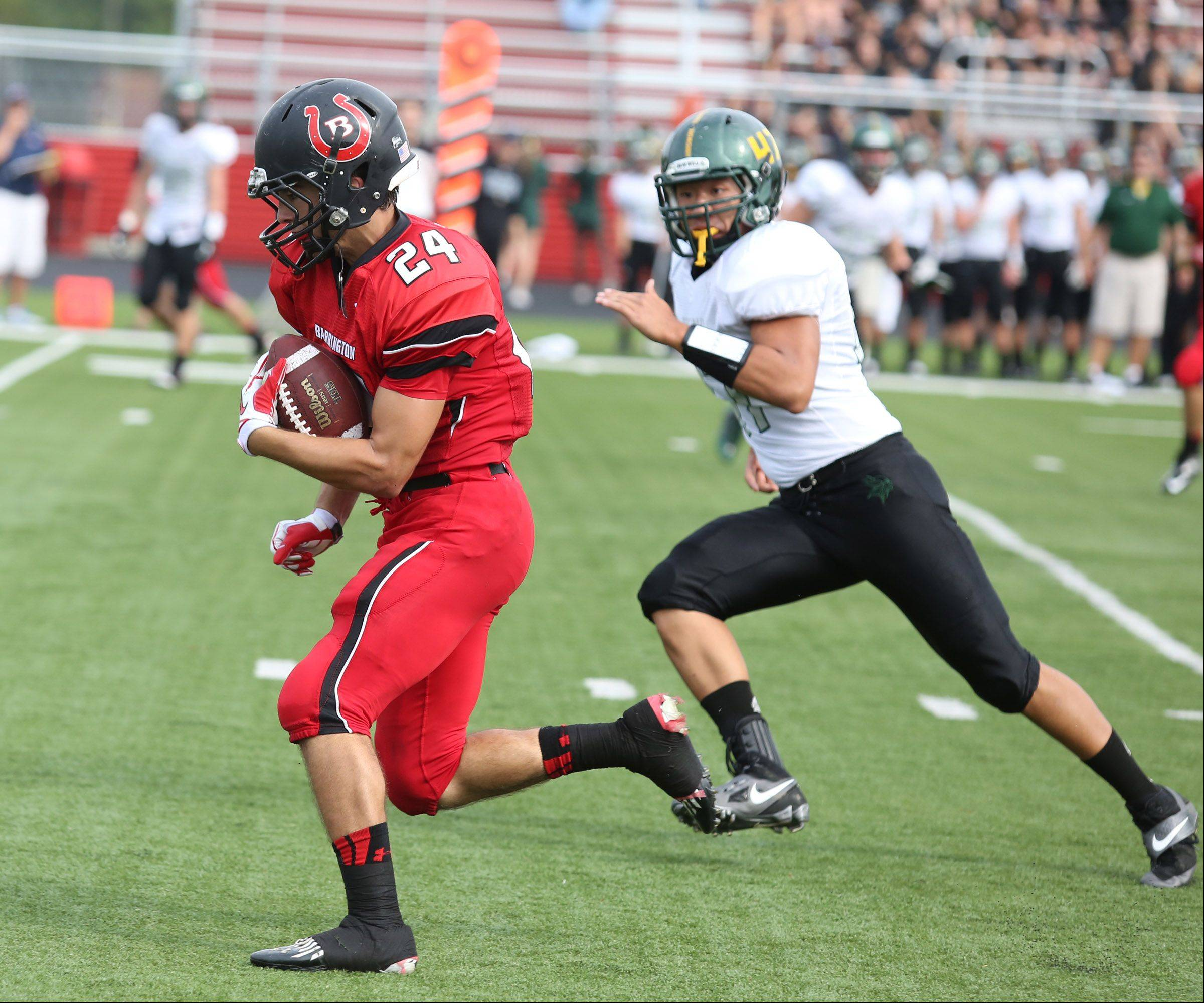 Barrington Dylan Bingham runs for a touchdown against Fremd at Barrington on Saturday, October 5.