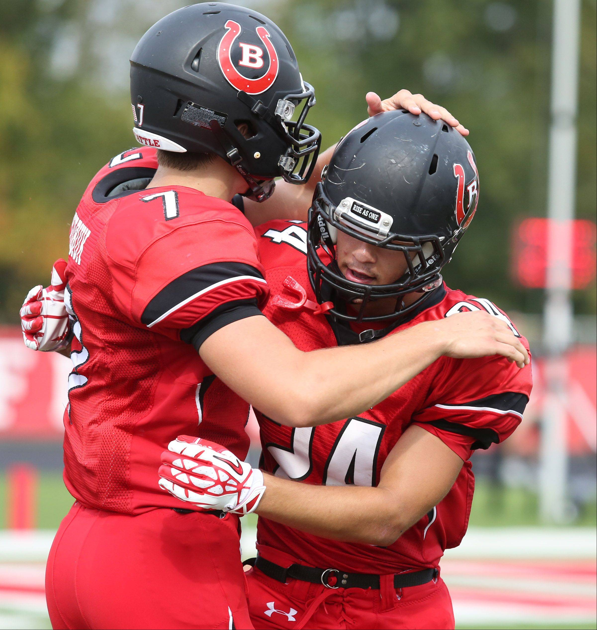 Barrington Dylan Bingham, right, gets a hand from quarterback Daniel Kubiuk after Bingham ran for a touchdown against Fremd at Barrington on Saturday, October 5.