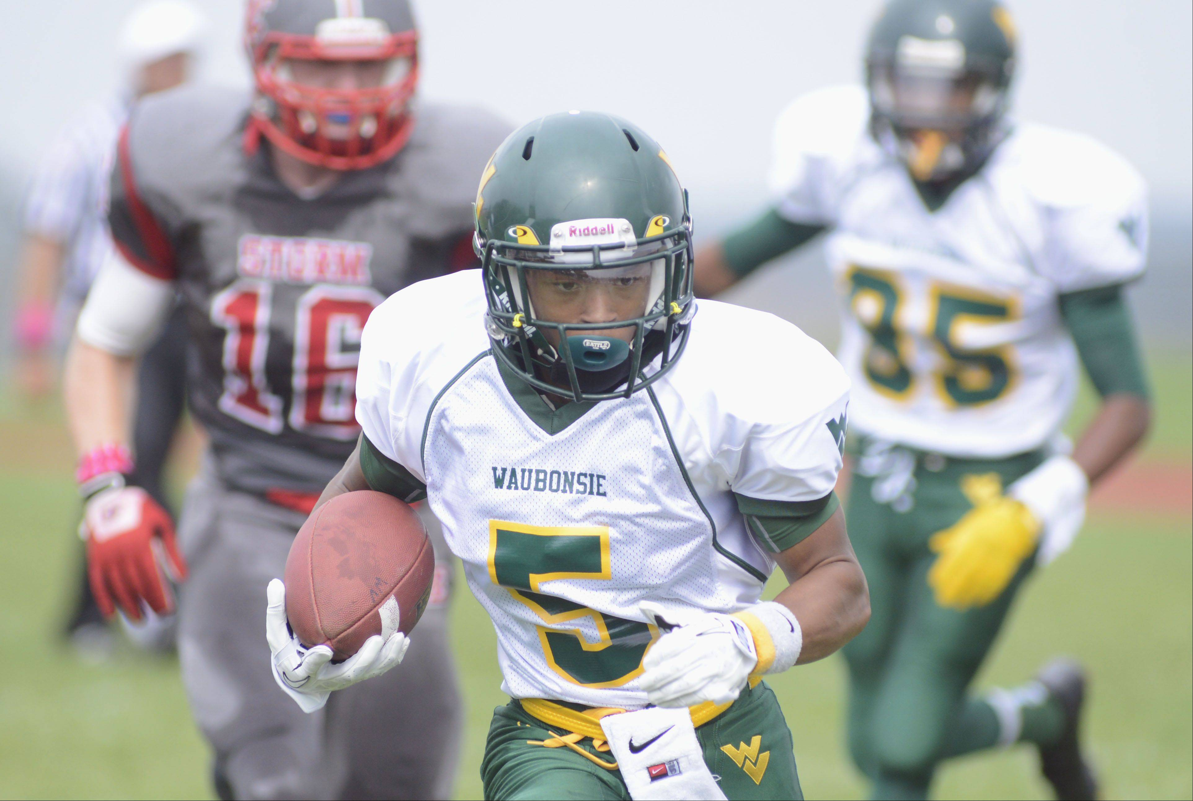 Waubonsie Valley's Devin Strickland makes his way to the end zone to score a touchdown in the first quarter on Saturday, October 5.