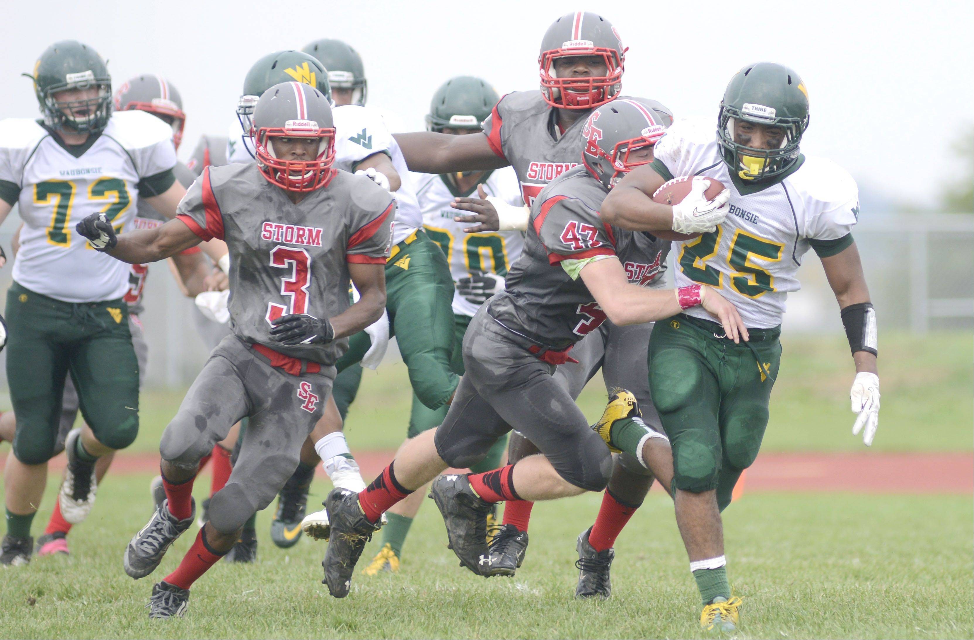 Waubonsie Valley's Jon Fizer shakes off South Elgin's Justin Bryski in the first quarter on Saturday, October 5.