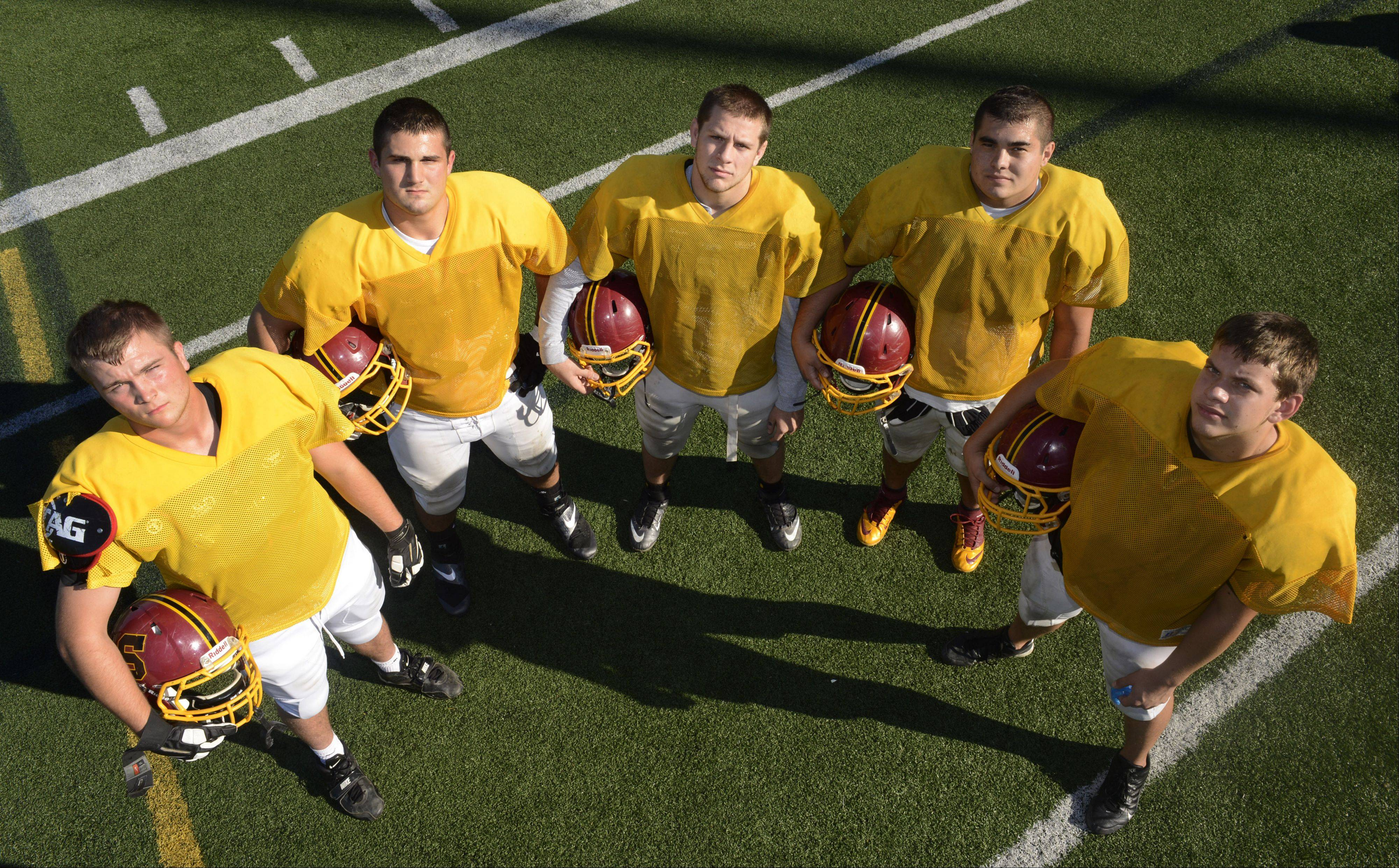 The offensive line of, from left, Alex Piotrowski, Matt Zolper, Matt Stopka, Justin Sanchez and Michael Bruno, is helping pave the way for a remarkable rushing season at Schaumburg.