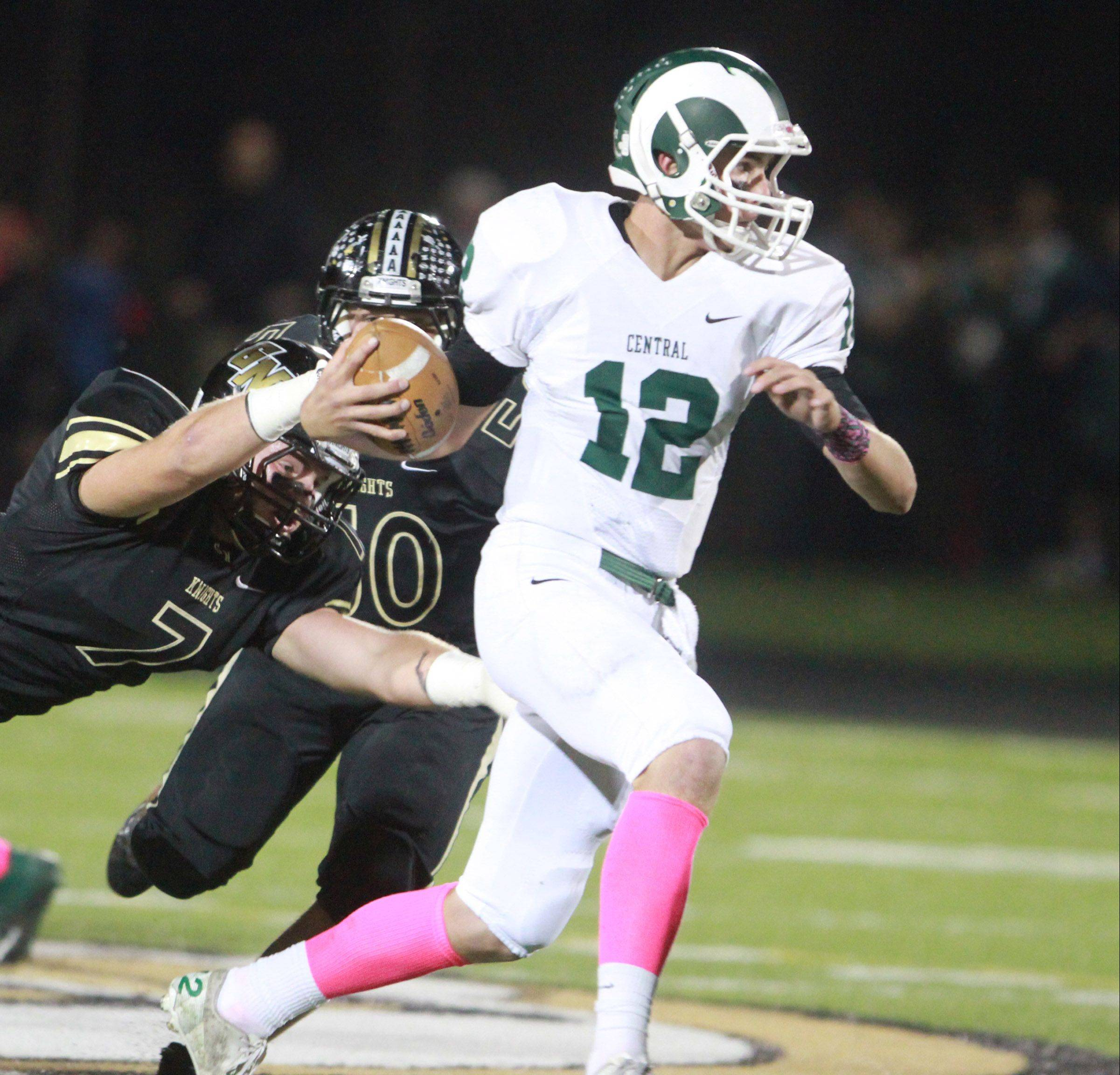 Grayslake Central quarterback Alex Lennartz runs the ball against host Grayslake North on Friday.