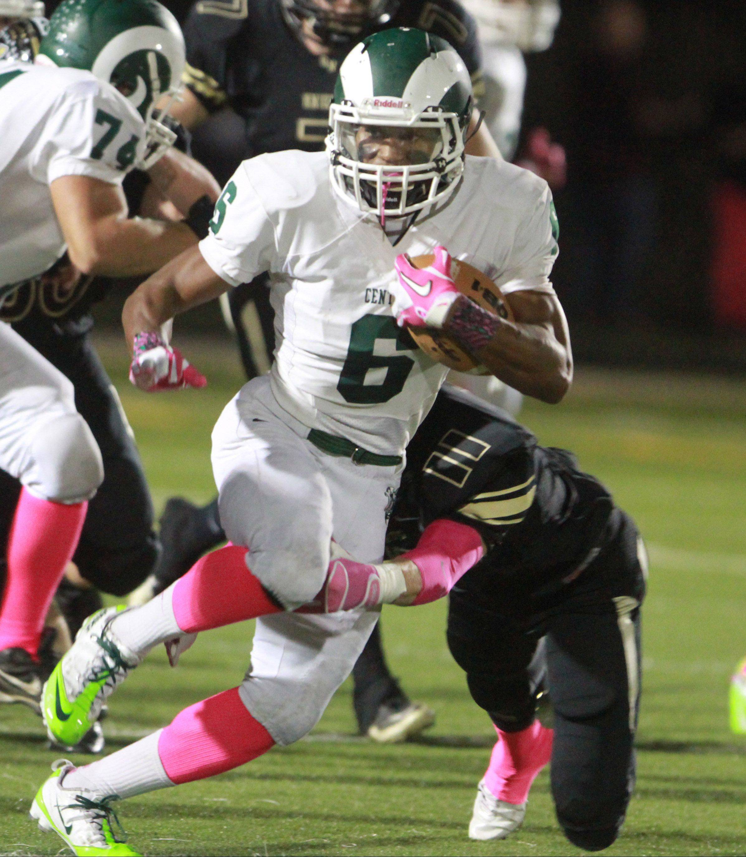 Grayslake Central's Malcolm Reed picks up yardage at Grayslake North on Friday.
