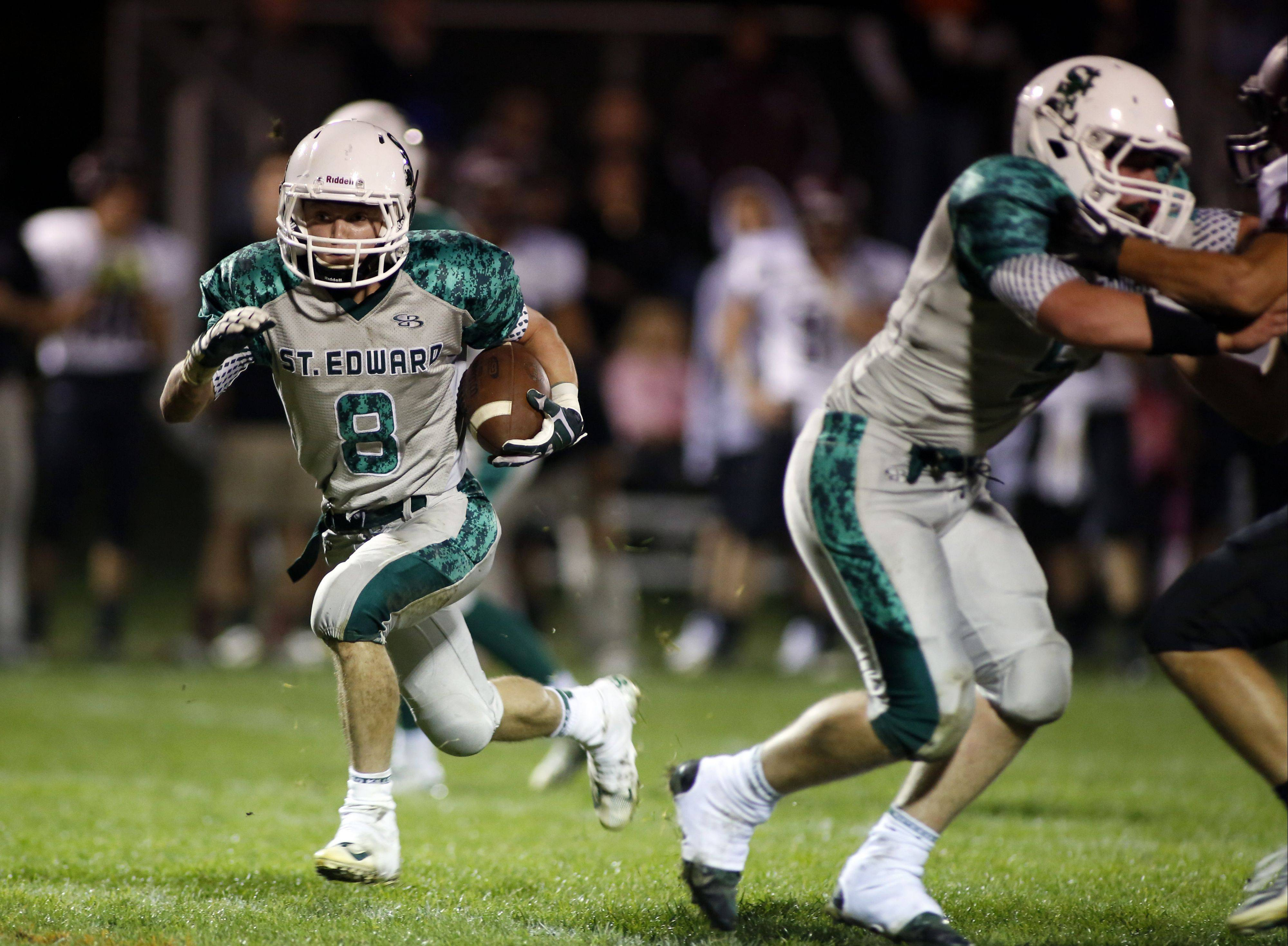 St. Edward's Michael Castoro rumbles in for a touchdown during the Green Wave's victory over Wheaton Academy on Friday at Greg True Field in Elgin.