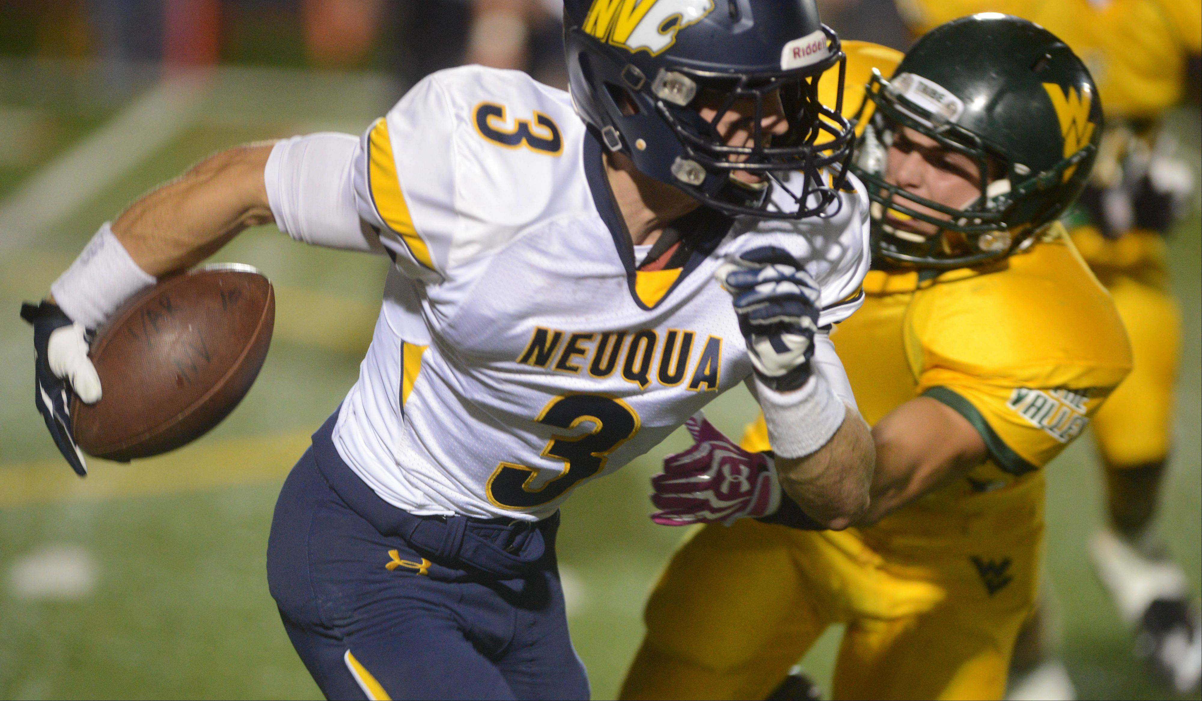 Mikey Dudek of Neuqua Valley runs the ball during the Wildcats' win over Waubonsie Valley at North Central College Friday.
