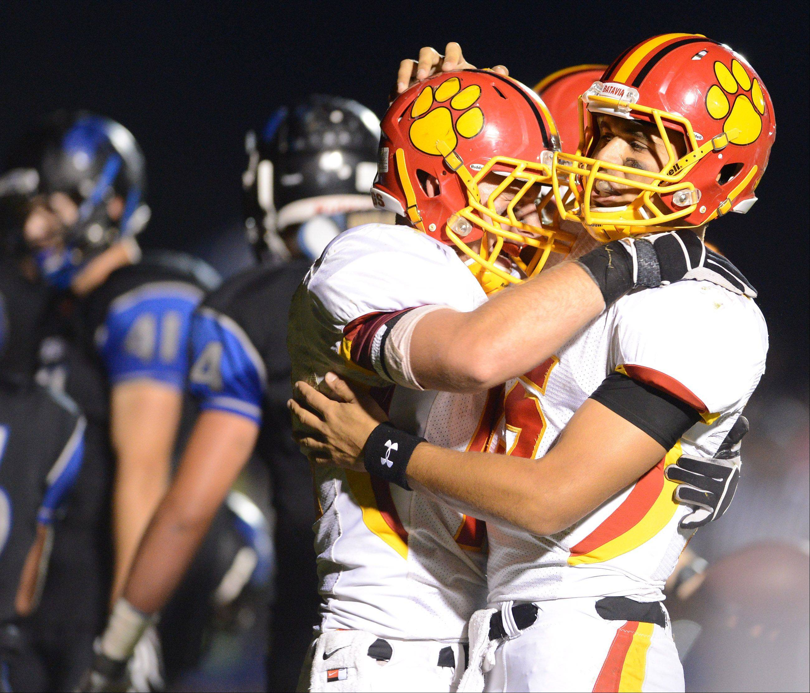 Batavia quarterback Micah Coffey congratulates Kevin Green after his touchdown reception.