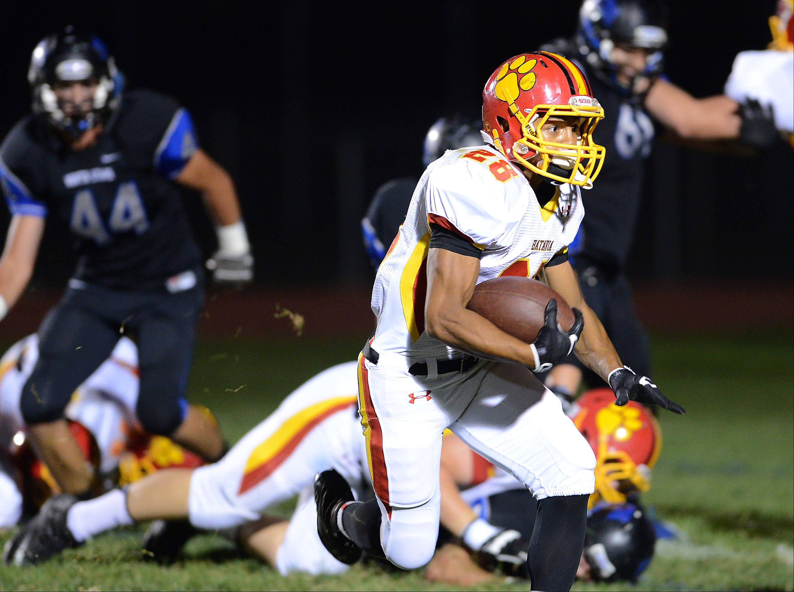 Batavia's Anthony Scaccia takes the ball outside to score on a 4th and 1 against St. Charles North.