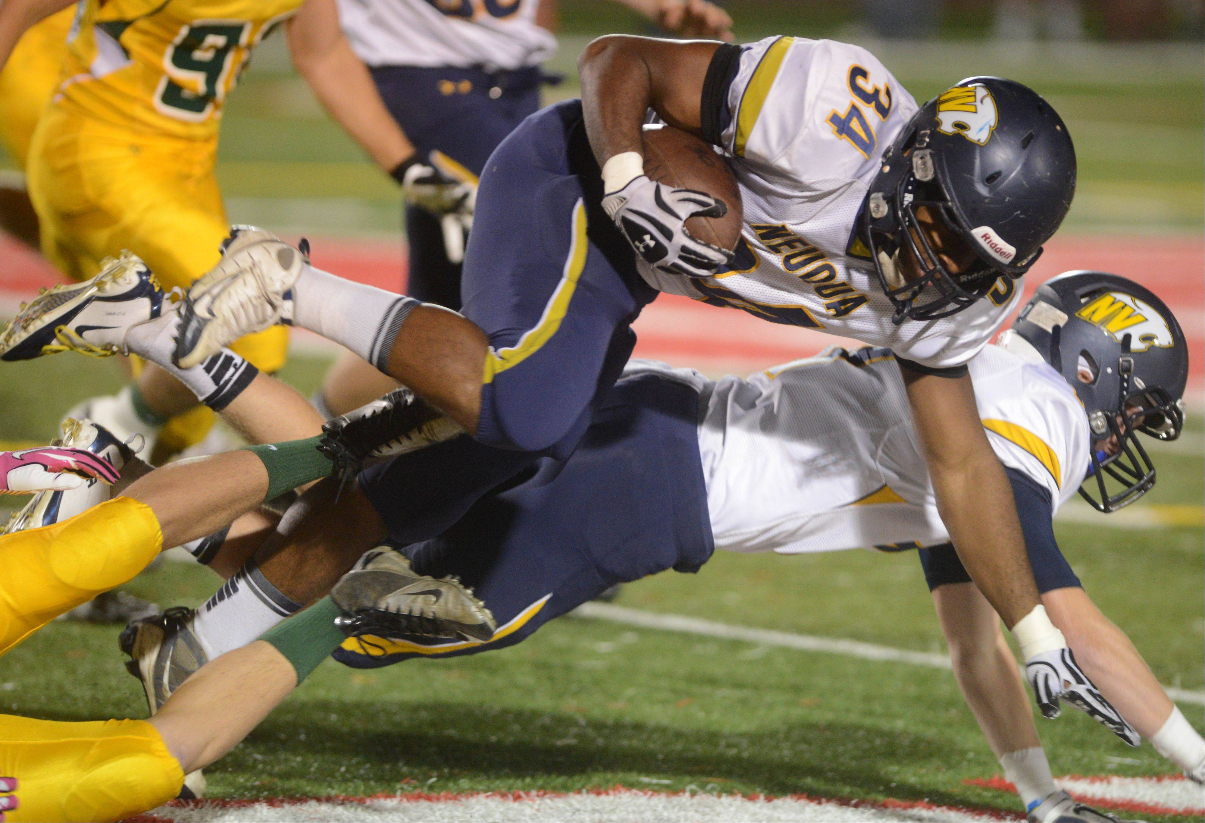 TJ Scruggs of Neuqua Valley moves the ball.