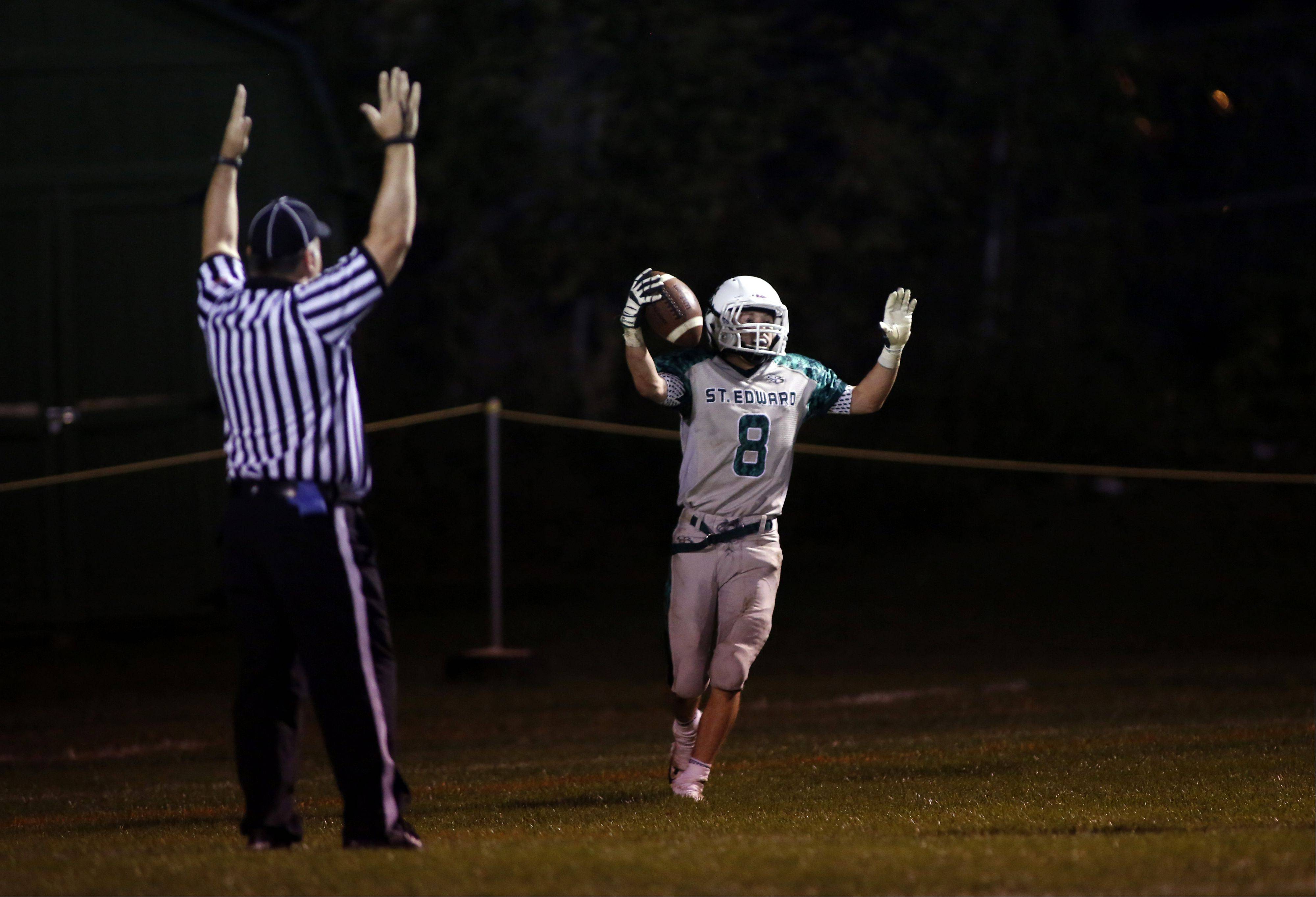 St. Edward's Michael Castoro celebrates after his second touchdown of the night.