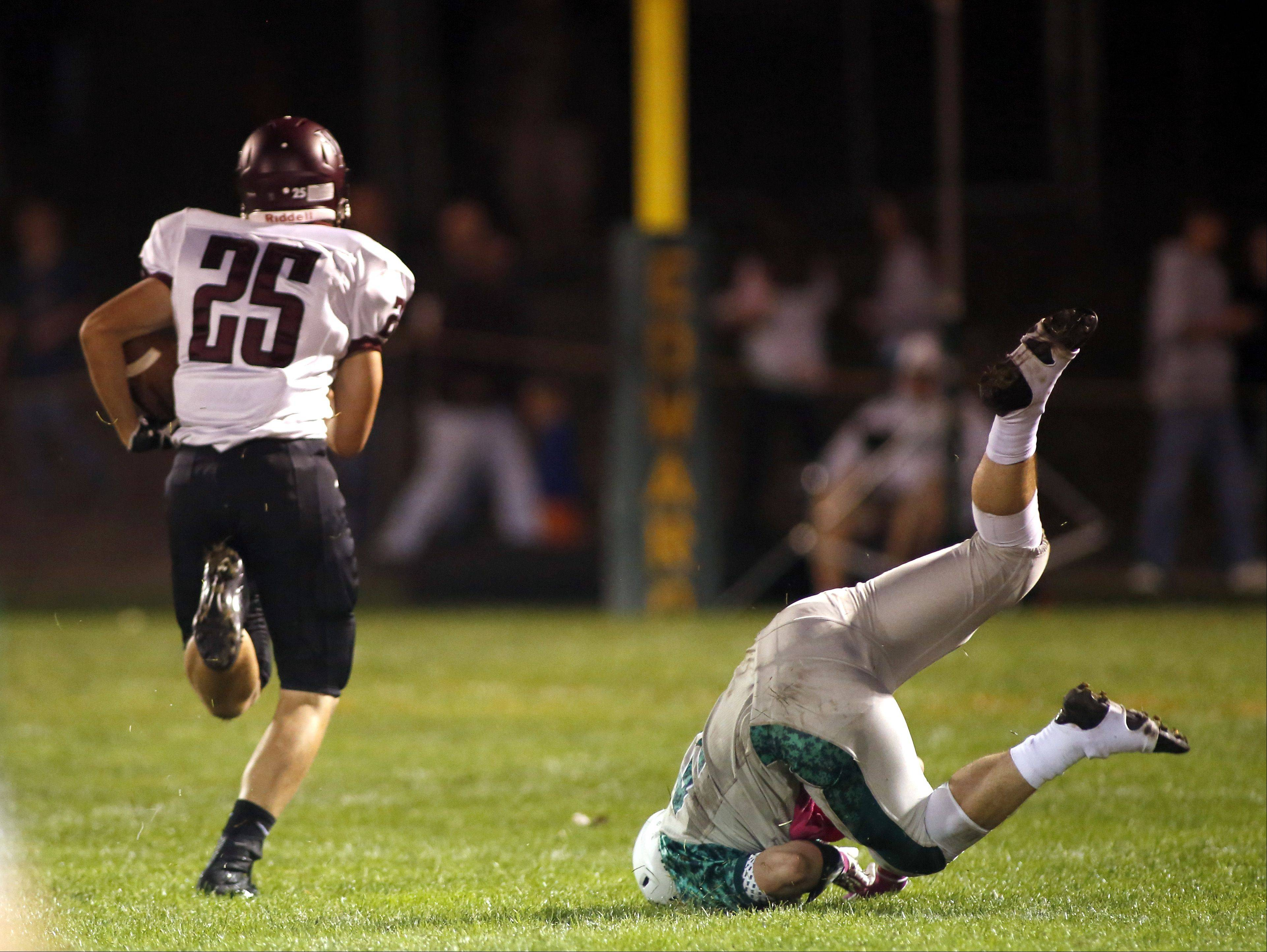 Wheaton Academy's Marino Costello heads in for a touchdown.