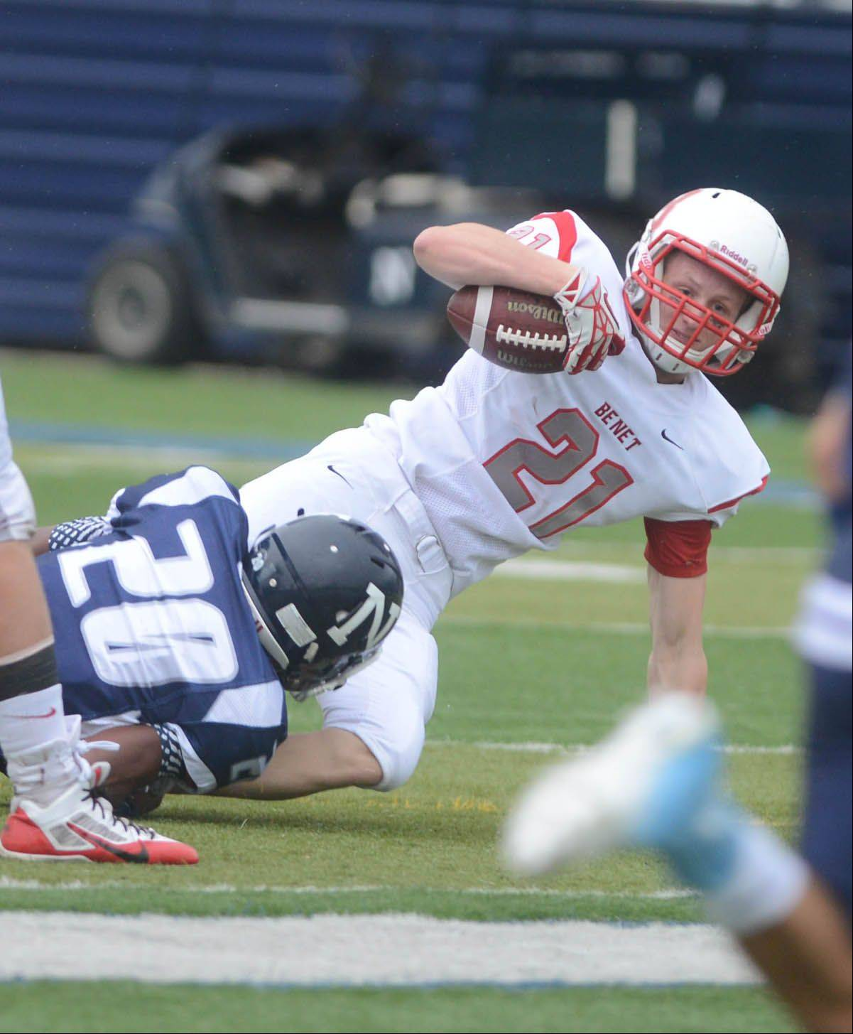 Ryan Parks of Benet is pulled down during the Benet at Nazareth football game Saturday.