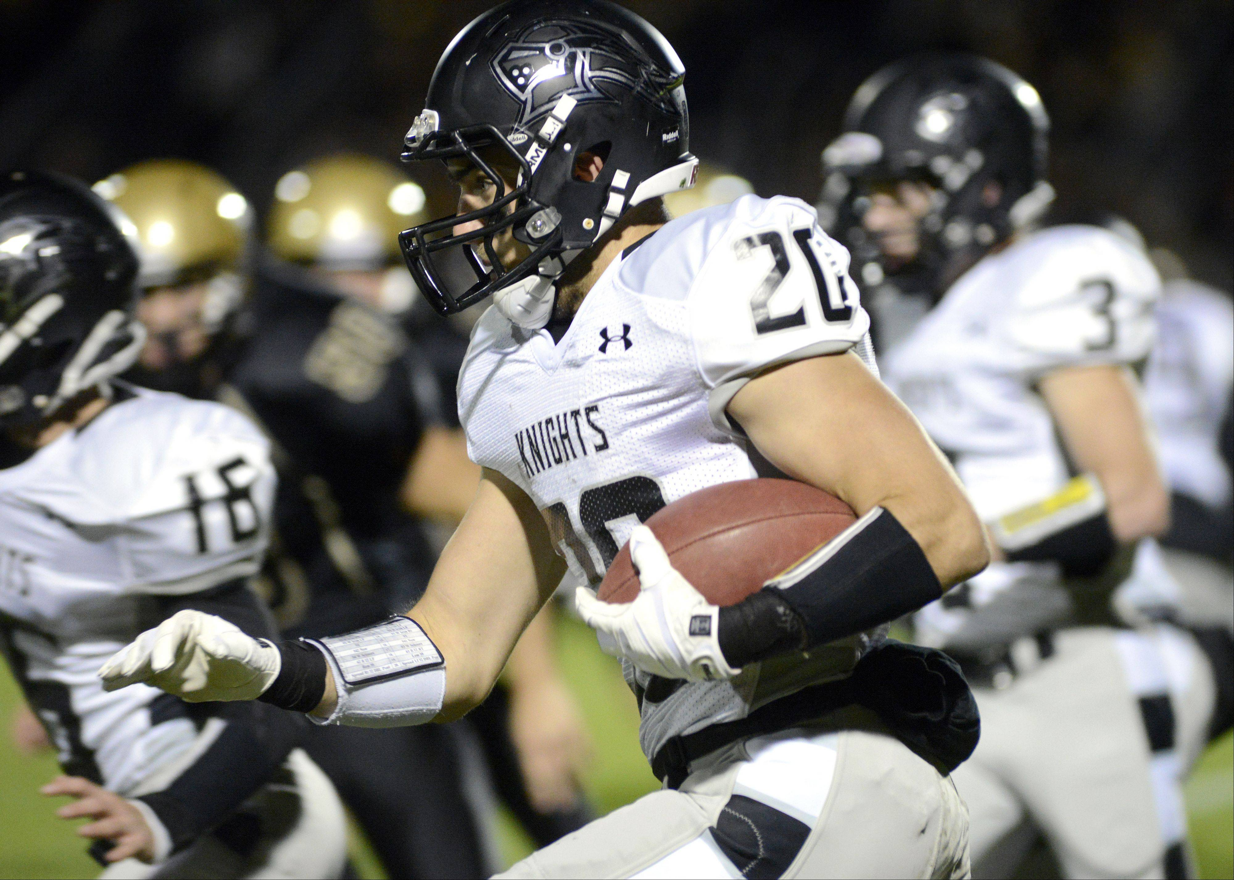 Kaneland's Dylan Nauert sprints down the center of the field in the first quarter vs. Sycamore on Friday