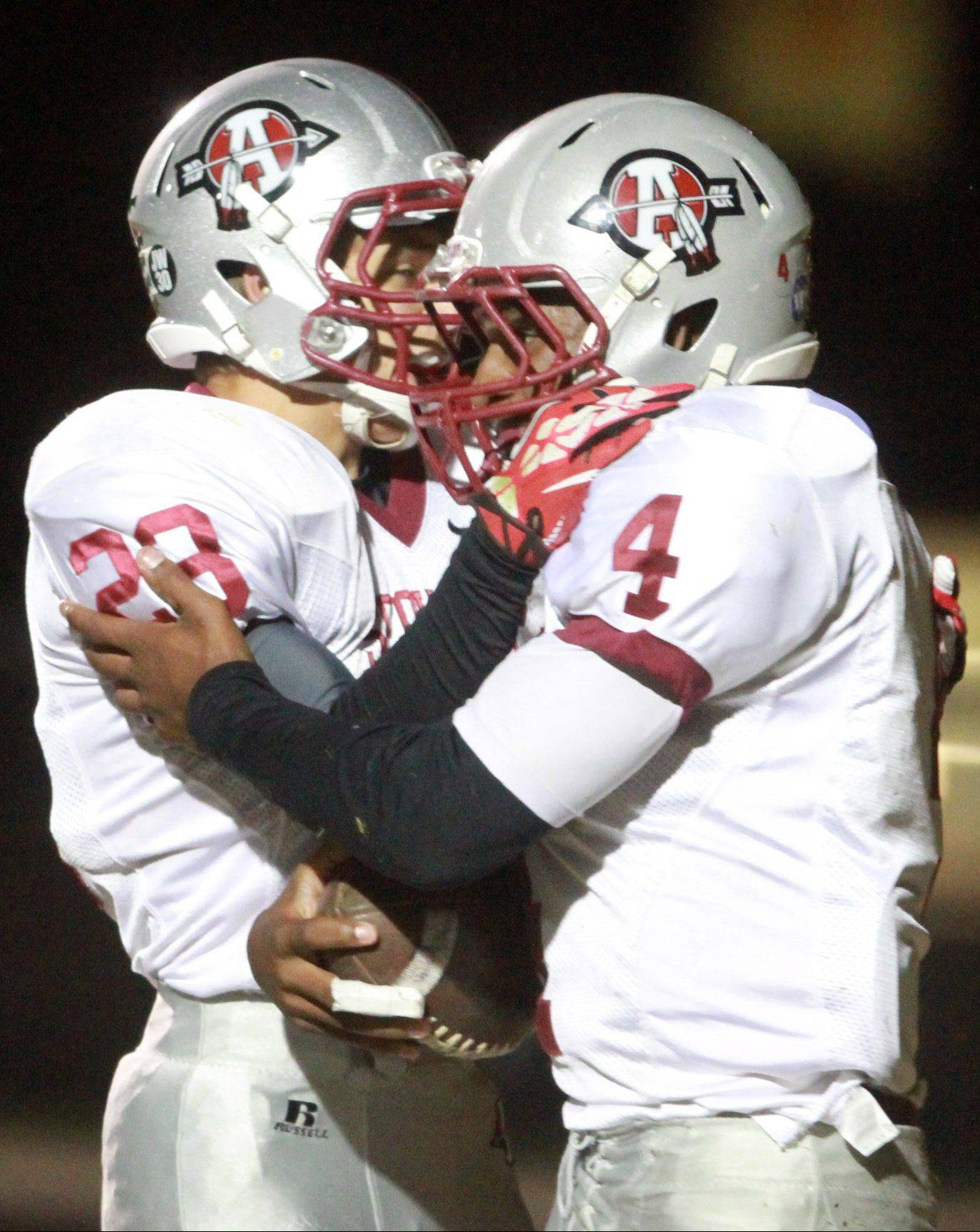 Antioch running back Griffin Hill, right, gets a hand from teammate Patrick Krause after running for the first touchdown of the game in the first quarter at Grant on Friday.