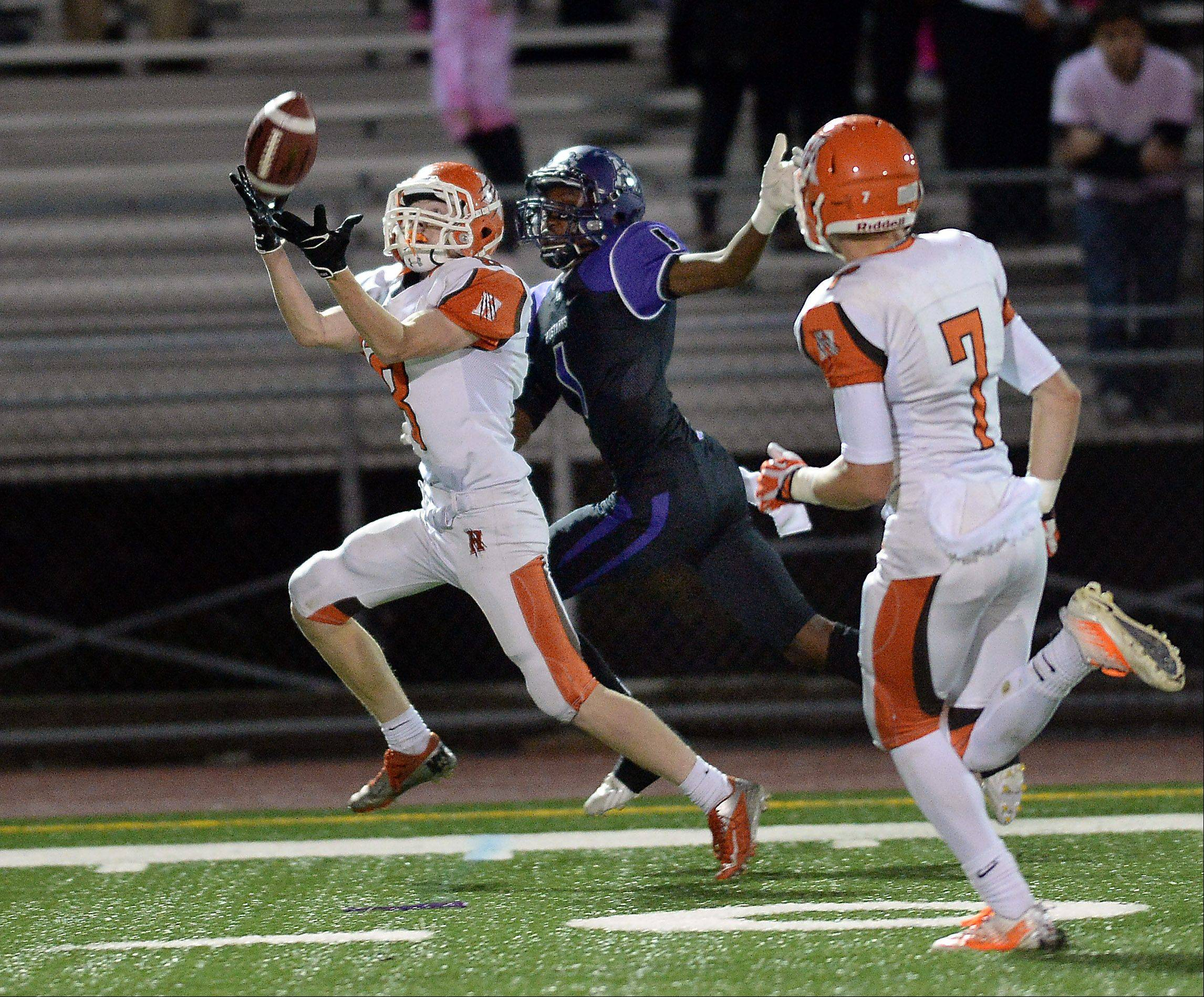 Hersey's Cole Monckton hauls in a pass that was intended for Rolling Meadows' Romello Boykin for a second-quarter interception Friday at Rolling Meadows.