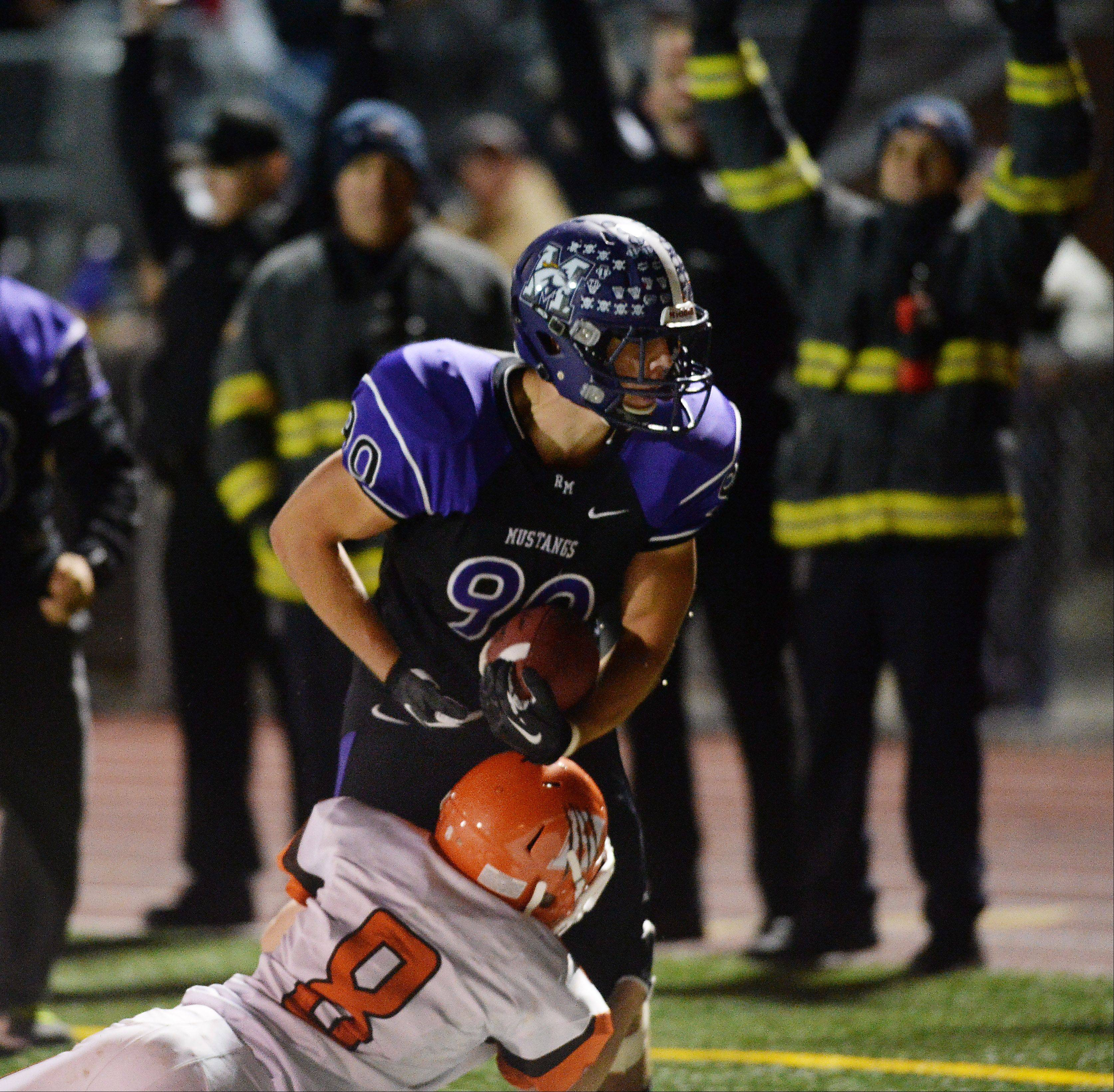 Rolling Meadows' Matt Campbell runs on a pass play in the fourth quarter with seconds left make a catch in the end zone to beat Hersey 24-21 .