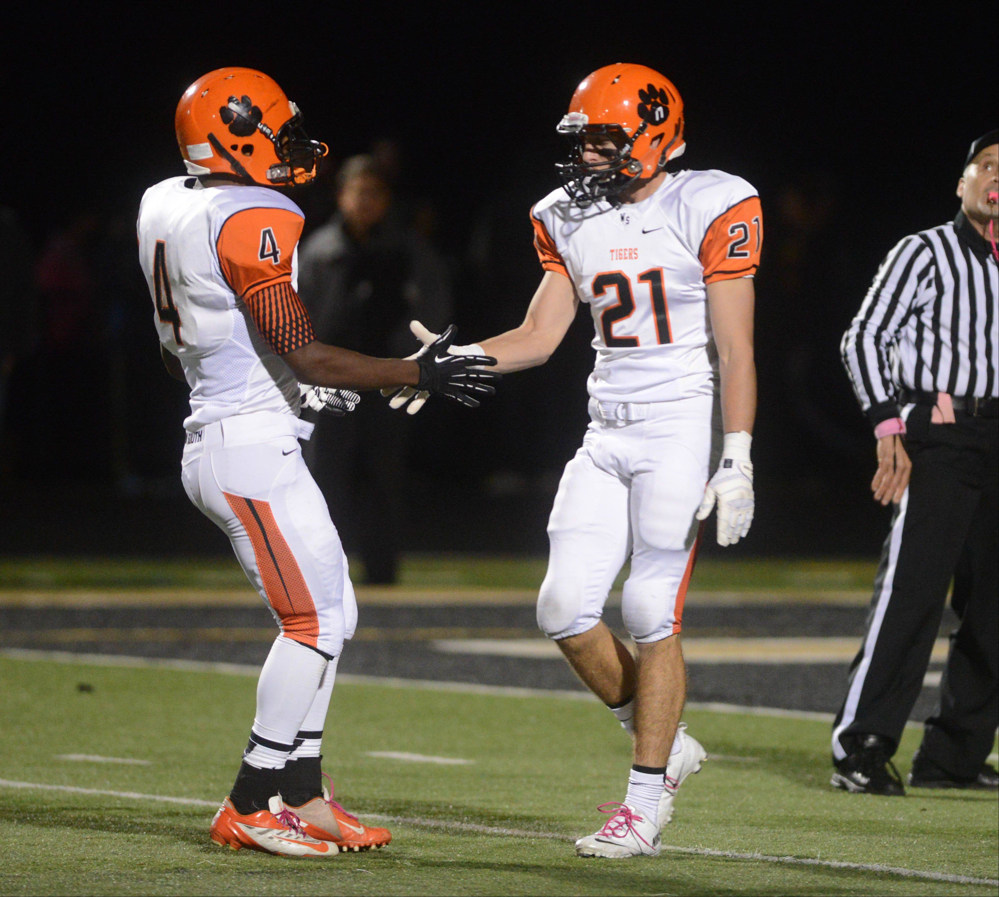 Ben Jackson,left, and Jake Schultz of Wheaton Warrenville South.